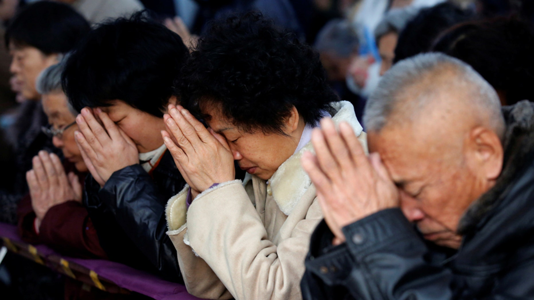 Believers take part in a weekend mass at an underground Catholic church in Tianjin November 10, 2013.