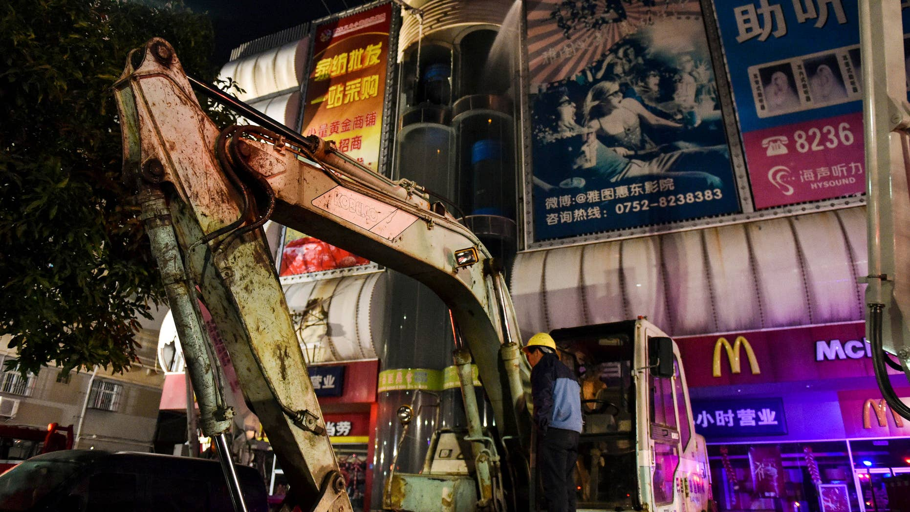 Feb. 6, 2015: China's Xinhua News Agency, fire fighters try to extinguish a fire at a wholesale market in Huidong County, southern Guangdong province.