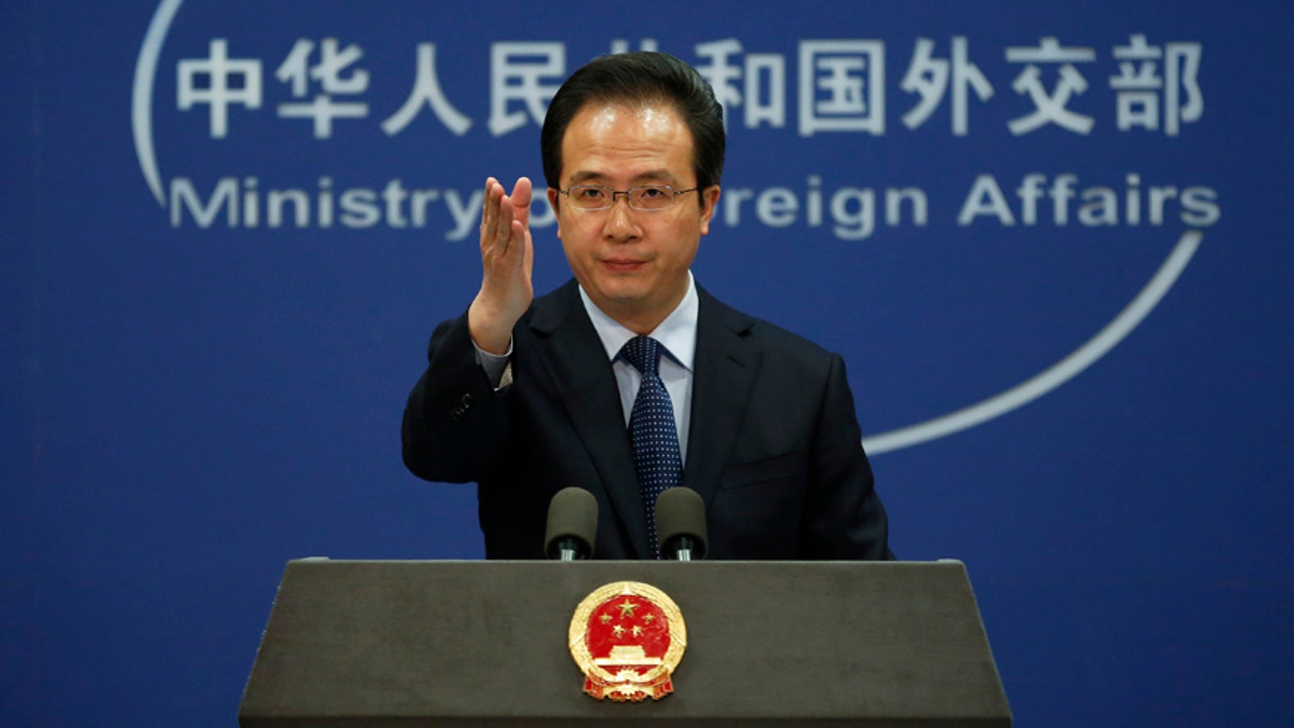 April 5, 2016: China's Foreign Ministry spokesman Hong Lei gestures during a daily briefing at the Ministry of Foreign Affairs office in Beijing.