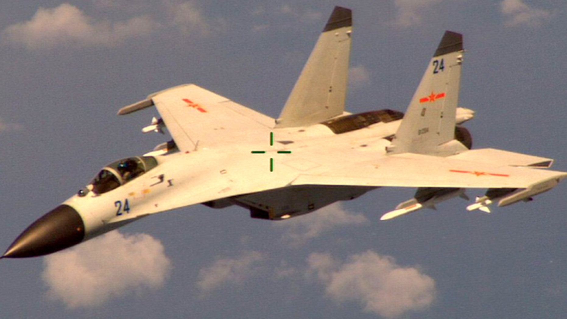 """Aug. 19, 2014: This handout photo provided by the Office of the Defense Secretary (OSD), taken shows a Chinese fighter jet that the Obama administration said Friday conducted a """"dangerous intercept"""" of a U.S. Navy surveillance and reconnaissance aircraft off the coast of China in international airspace."""
