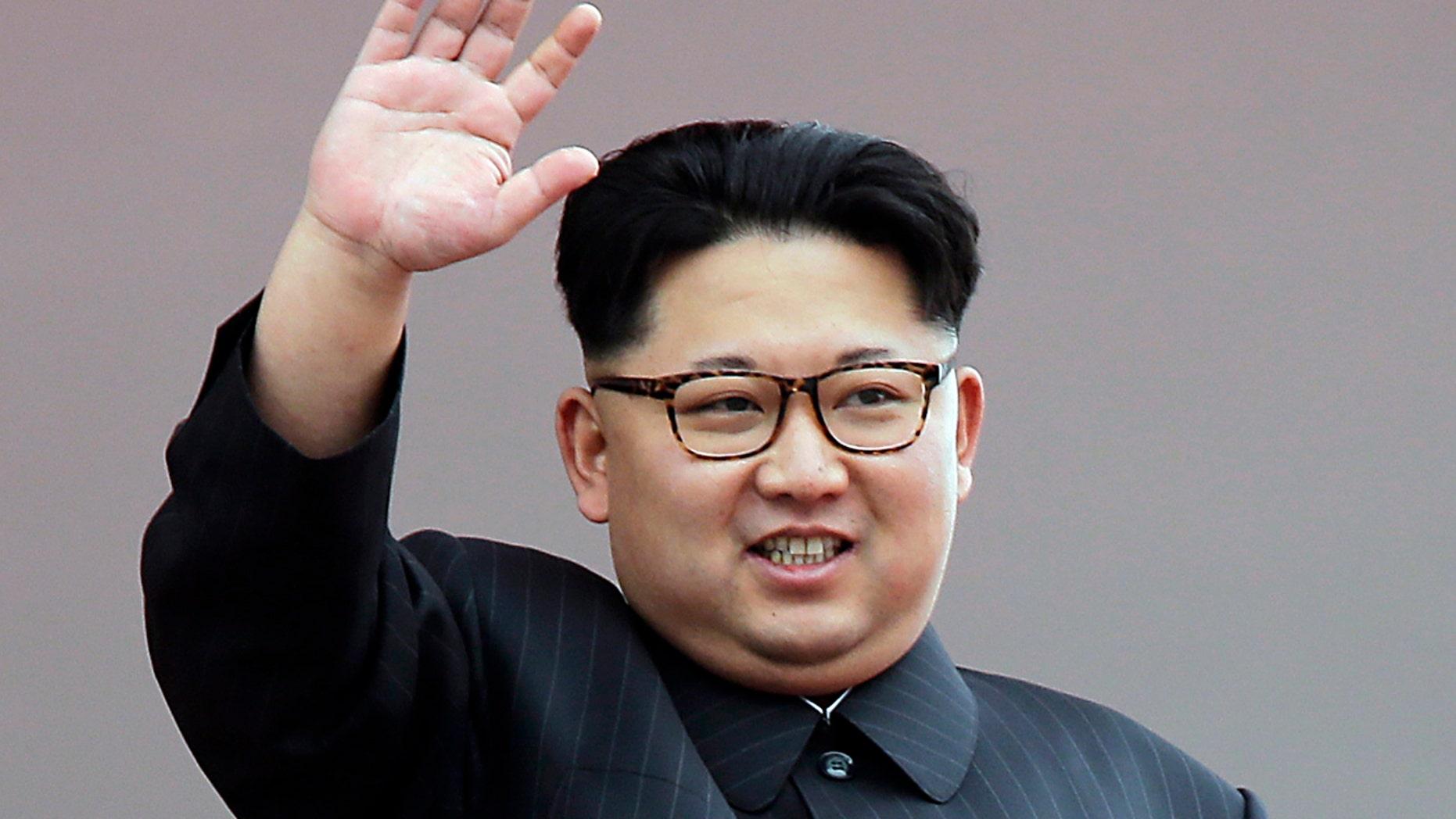 FILE - In this May 10, 2016, file photo, North Korean leader Kim Jong Un waves at parade participants at the Kim Il Sung Square in Pyongyang, North Korea. (AP Photo/Wong Maye-E)