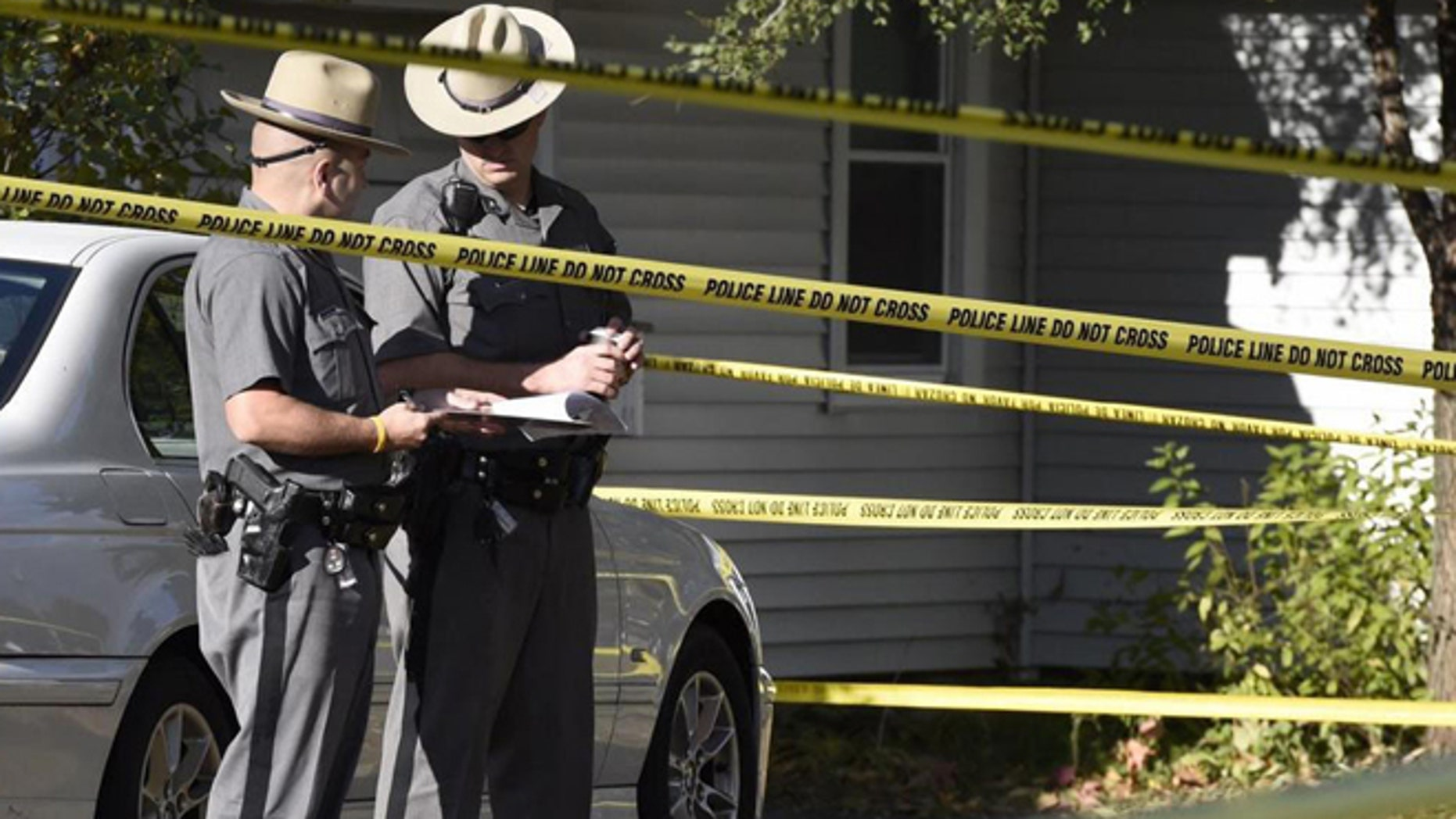 Oct. 10, 2014: Authorities work the scene of a quadruple homicide in Guilderland, N.Y., where Jin Chen, his wife and their two children were found fatally stabbed.