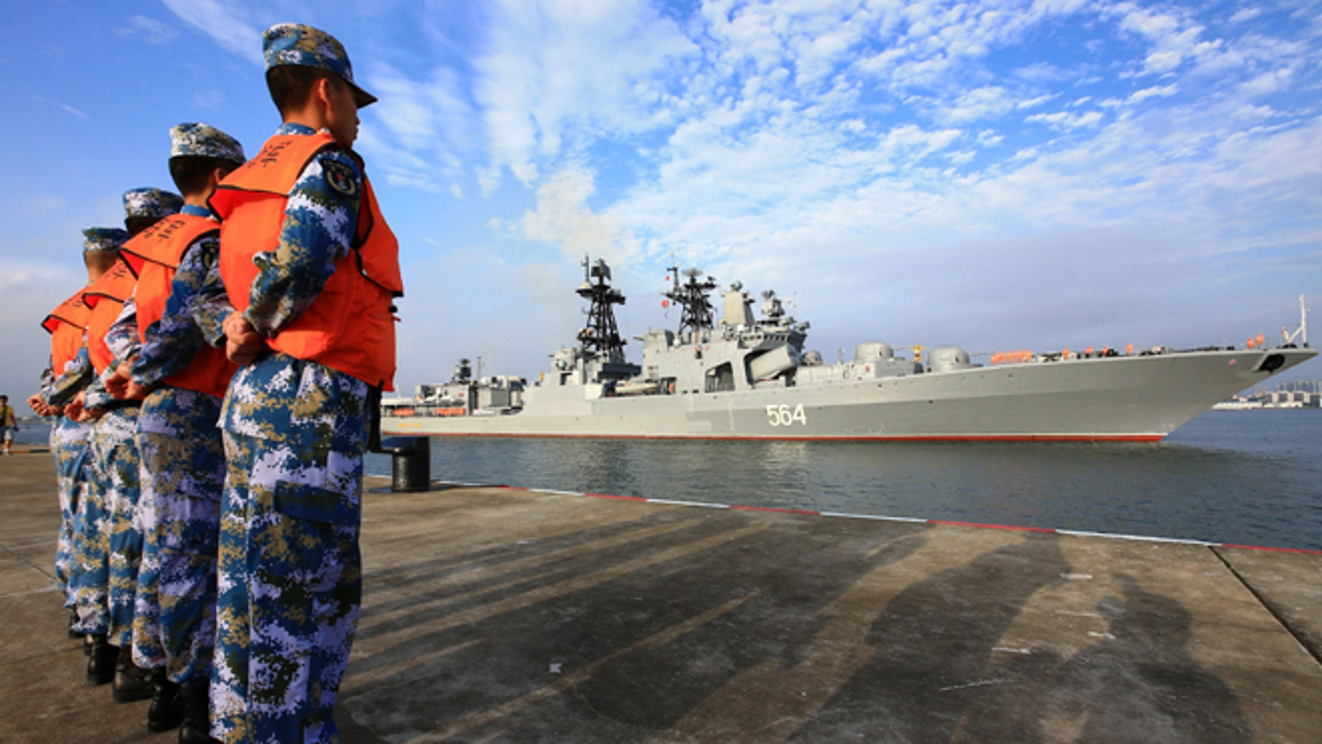 In this photo released by China's Xinhua News Agency, a Russian naval ship arrives in port in Zhanjiang in southern China's Guangdong Province, Monday, Sept. 12, 2016.
