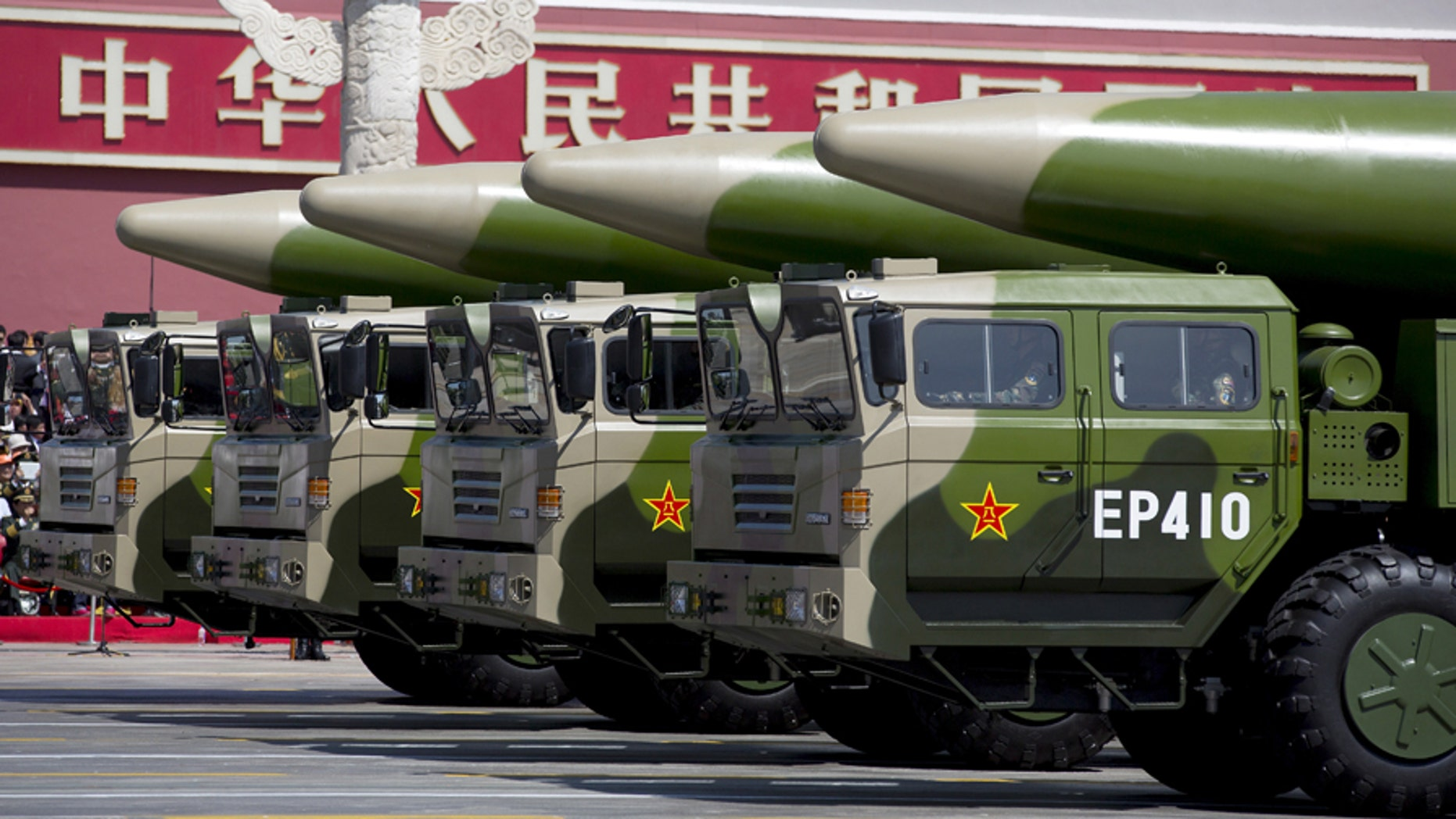 File photo - Military vehicles carrying DF-26 ballistic missiles travel past Tiananmen Gate during a military parade to commemorate the 70th anniversary of the end of World War II in Beijing Thursday Sept. 3, 2015. (REUTERS/Andy Wong/Pool)