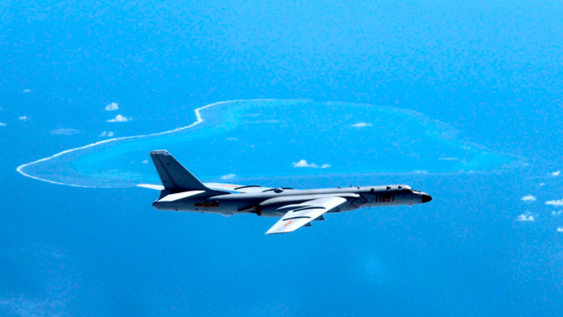 In this undated file photo released by Xinhua News Agency, a Chinese H-6K bomber patrols the islands and reefs in the South China Sea.