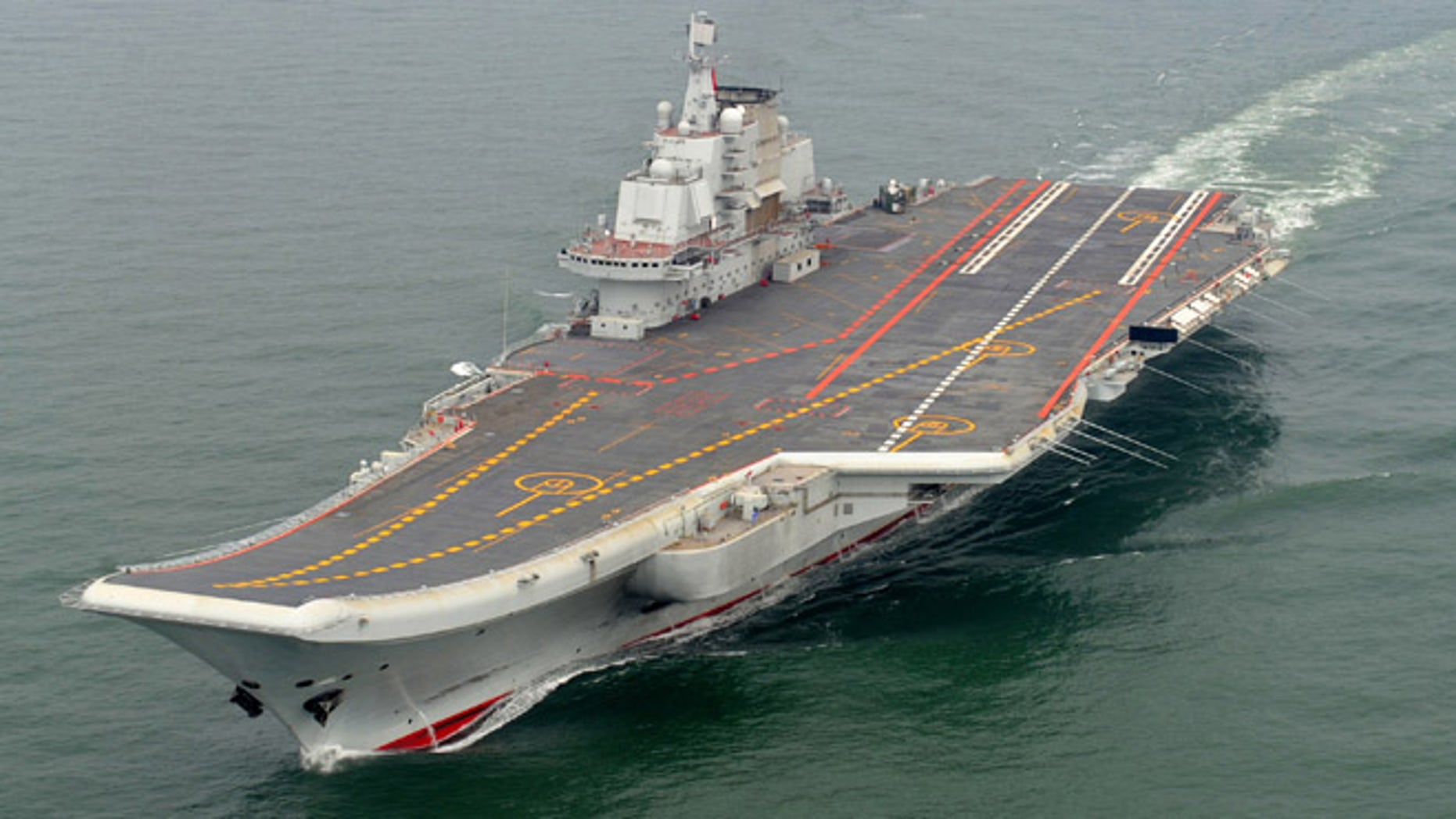 FILE: Chinese aircraft carrier Liaoning cruises for a test on the sea.
