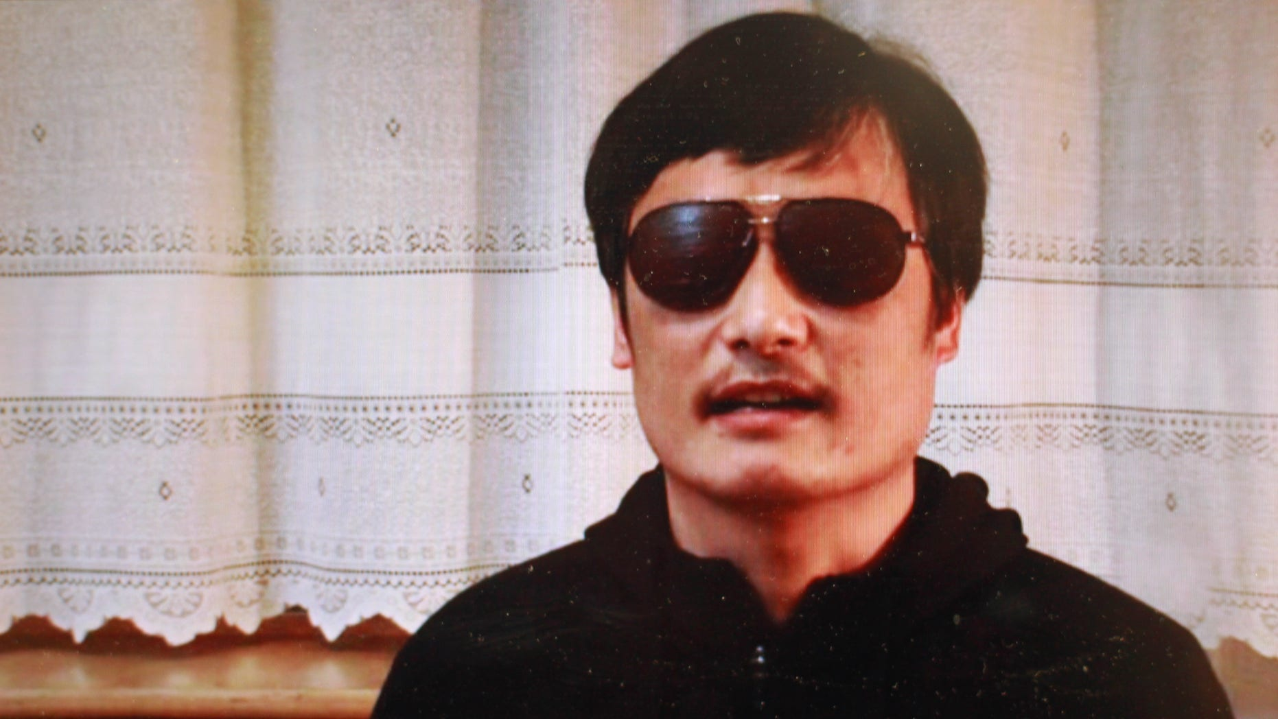This file image made from video posted to YouTube April 27, 2012 by by overseas Chinese news site Boxun.com, shows blind legal activist Chen Guangcheng.