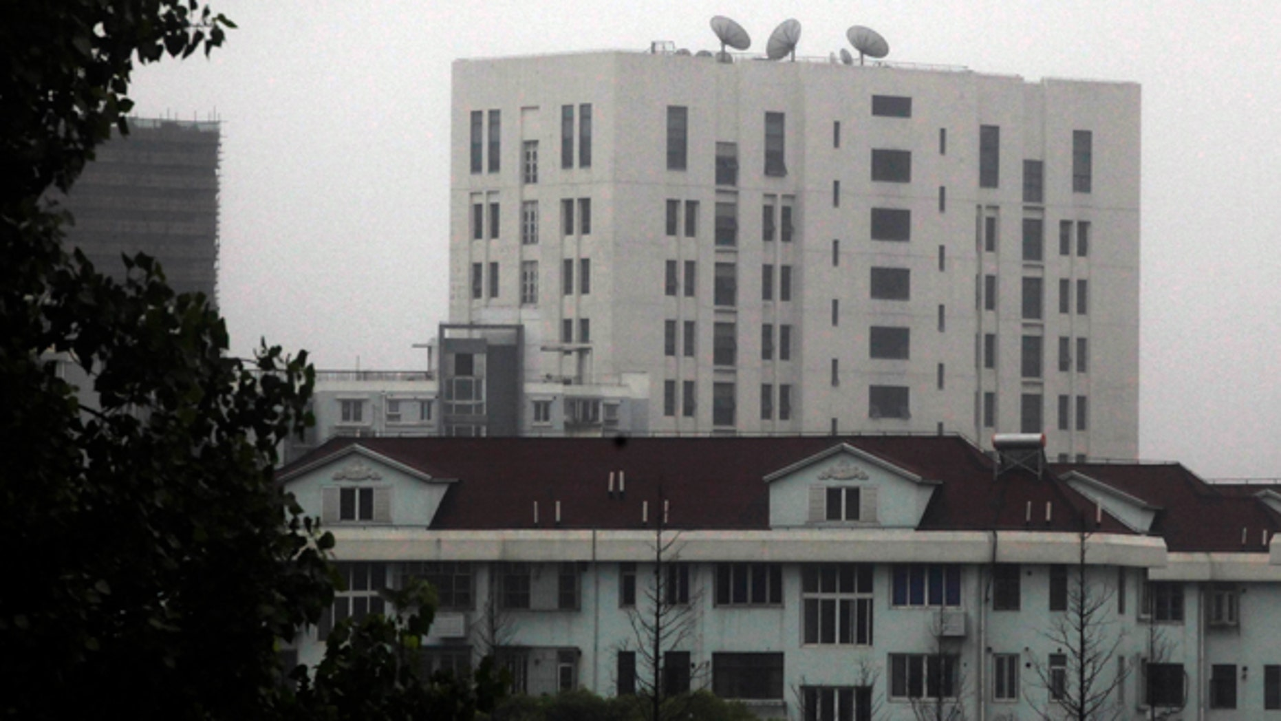 This May 31, 2013 photo shows the building housing Unit 61398 of the Peoples Liberation Army, center top, in the outskirts of Shanghai, China. After years of quiet and largely unsuccessful diplomacy, the U.S. has brought its persistent computer-hacking problems with China into the open, delivering a steady drumbeat of reports accusing Beijings government and military of computer-based attacks against America. Officials say the new strategy may be having some impact.