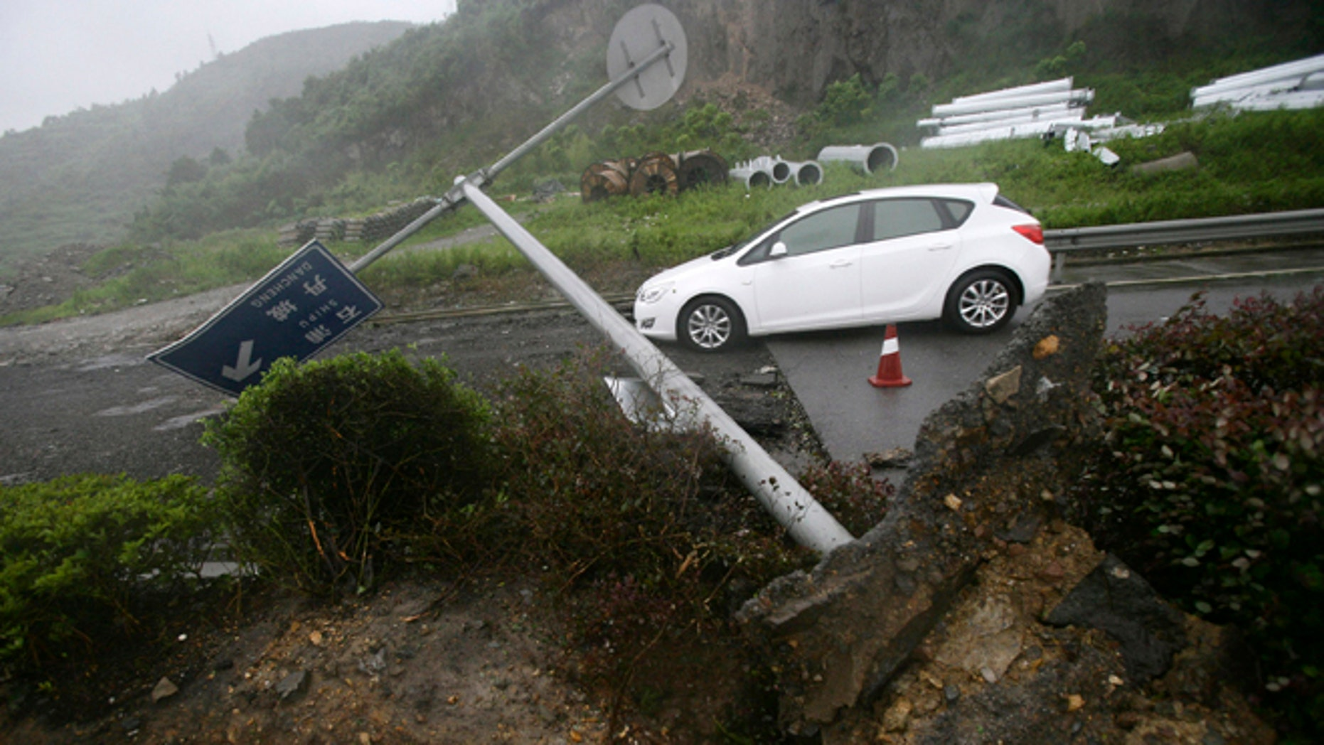 Aug. 8, 2012: In this photo released by China's Xinhua News Agency, a road sign is blown down in Xiangshan County, east China's Zhejiang Province.