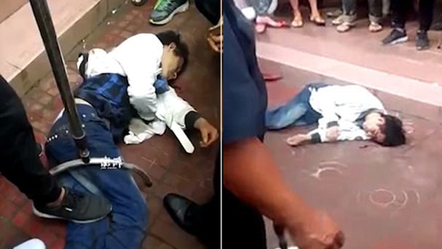Video at a school in China showed a man on the ground after he allegedly barged into an elementary school and slashed five children.