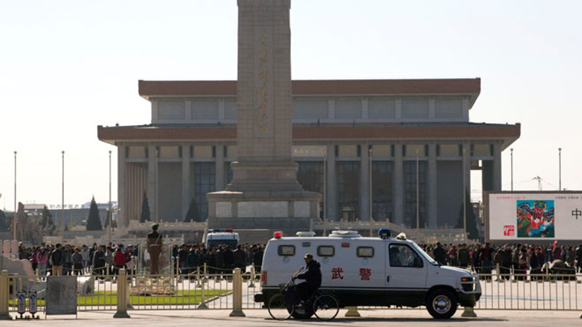 Oct. 29, 2013: An armored Chinese paramilitary vehicle is stationed near Tiananmen Square across the street from Tiananmen Gate, the site of an incident Monday where a car plowed through a crowd before it crashed and burned in Beijing, China.