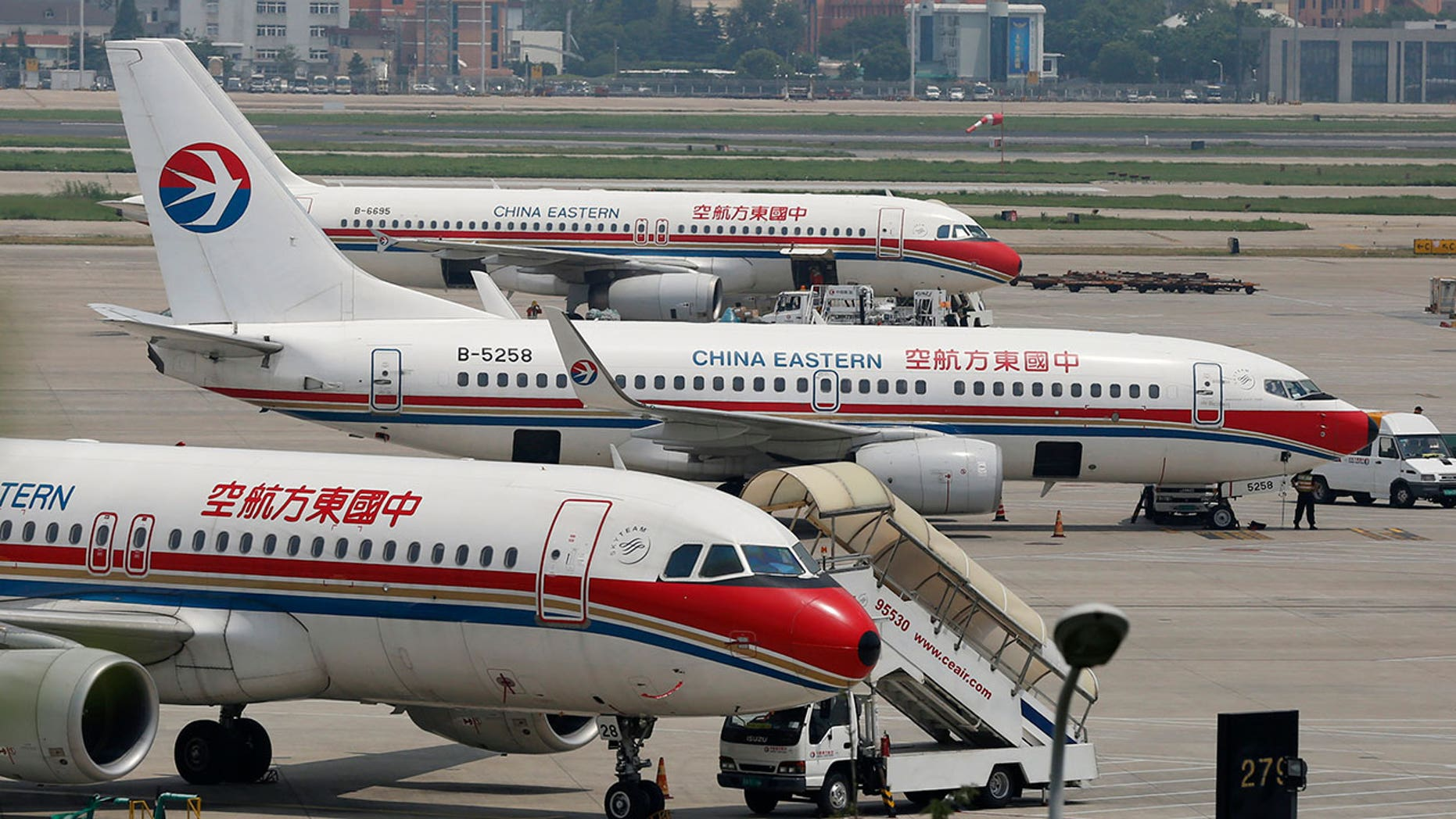 Passengers suffered cuts, bruises and fractures following a turbulent flight aboard China Eastern Airlines.