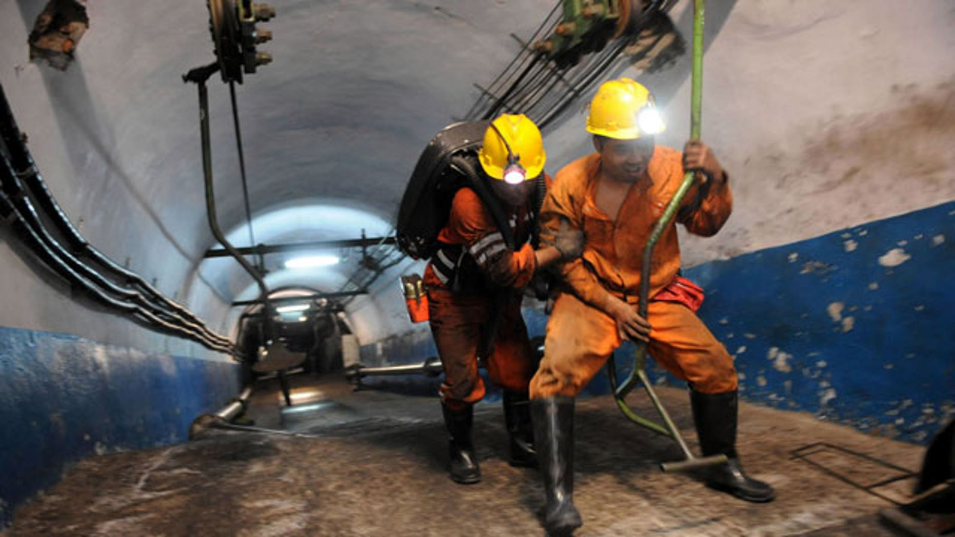 escuers are ready to go underground after an explosion at the state-run Pingyu Coal & Electric Co. Ltd mine in Yuzhou city, central China's Henan province, on Saturday Oct. 16, 2010. Rescuers battled dangerous levels of gas and the risk of falling coal as they worked to free 17 miners after the explosion at the coal mine in central China early Saturday.