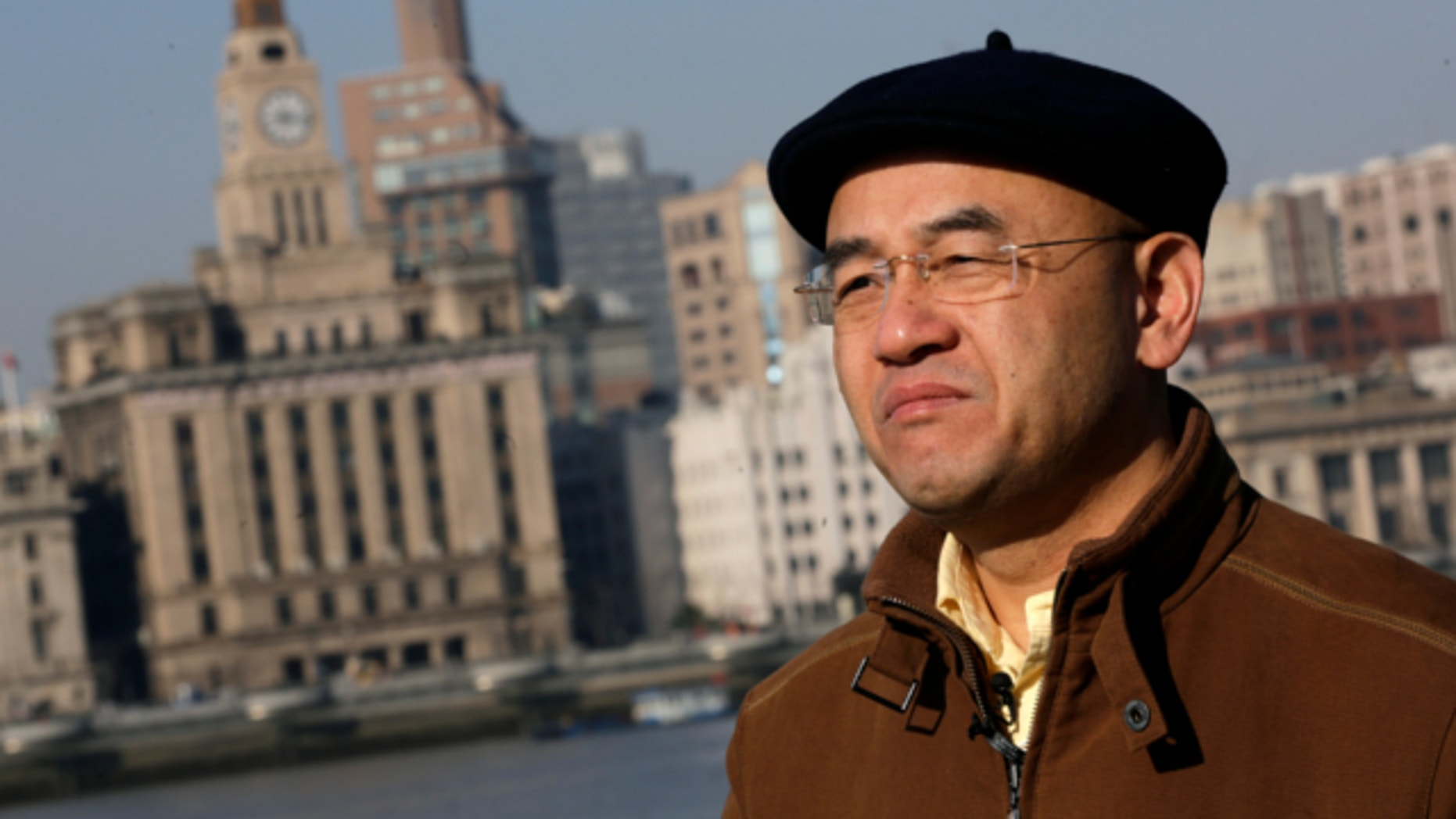 Jan. 28, 2013: Chinese-born U.S. scientist Hu Zhicheng stands at the waterfront promenade along the Huangpu River in Shanghai, China.