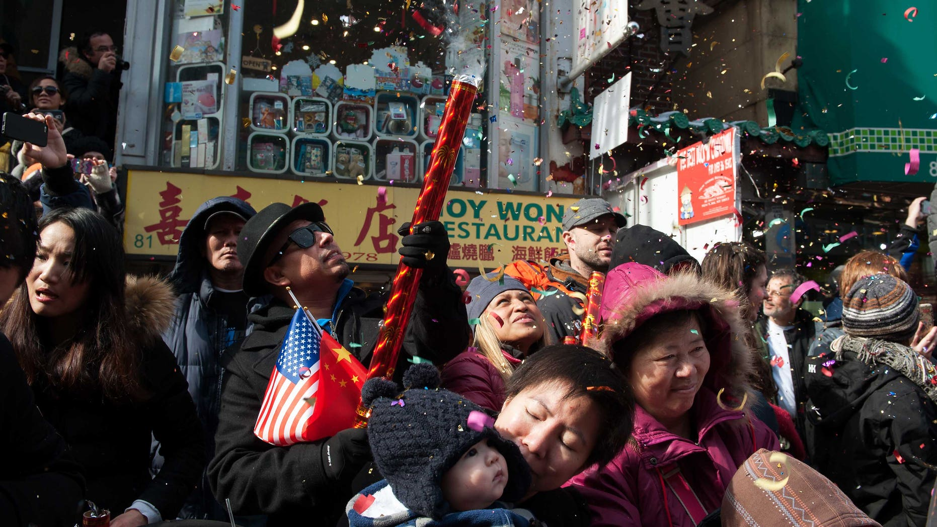 NEW YORK, NY - FEBRUARY 22: Revelers shoot confetti in the Chinese New Year parade in Manhattan's Chinatown on February 22, 2015 in New York City. The parade, now in it's 16th year, brought out hundreds of participants and viewers to celebrate the Year of the Sheep.  (Photo by Bryan Thomas/Getty Images)