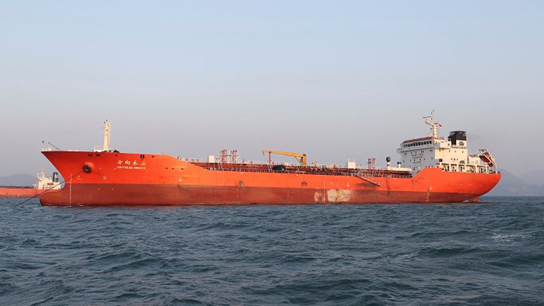 The Lighthouse Winmore, a Hong Kong-flagged ship, was seen in the waters off Yeosu, South Korea. South Korean authorities boarded the ship and interviewed its crew members for allegedly violating U.N. sanctions by transferring oil to a North Korean vessel in October.
