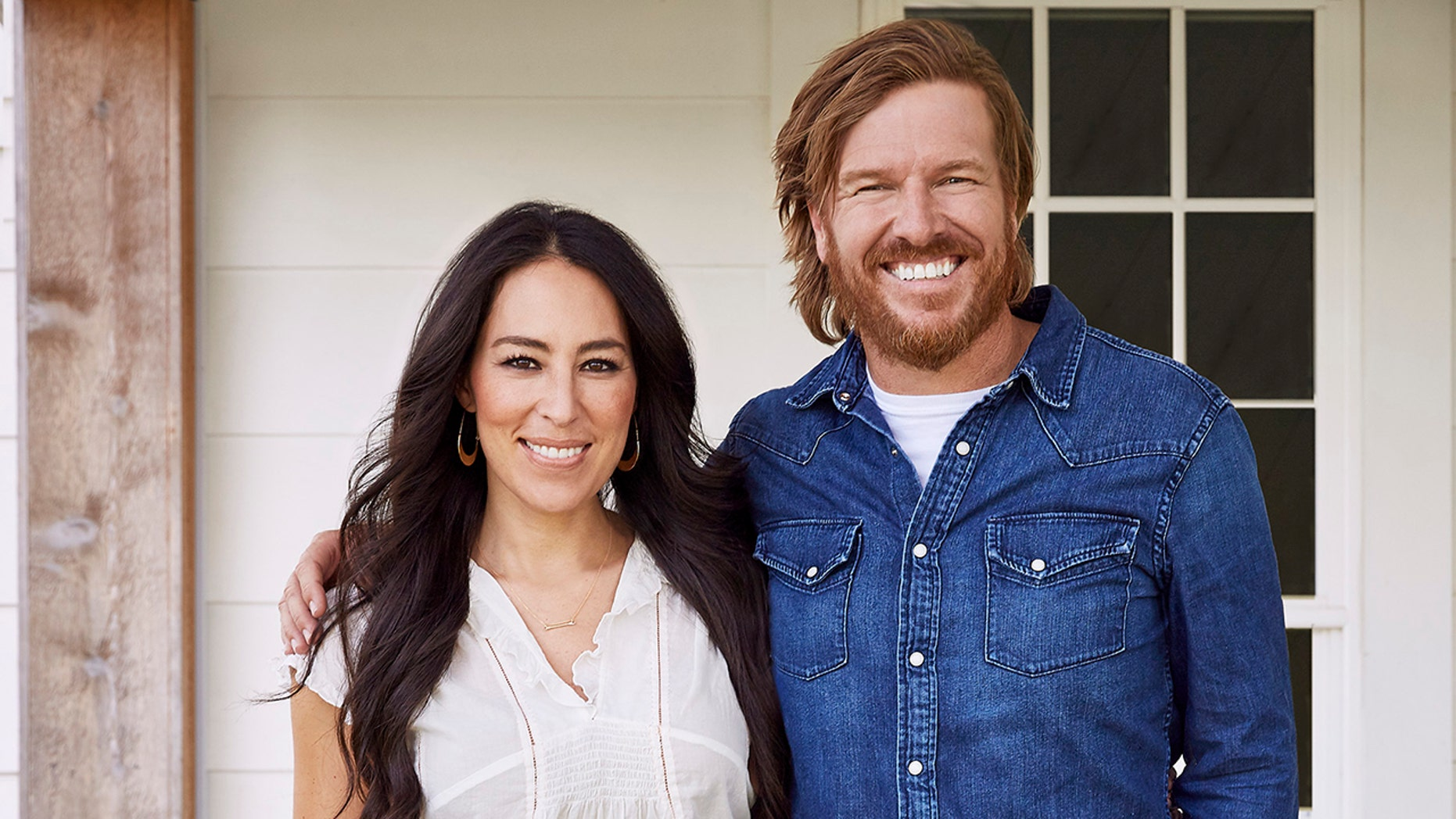 Chip and Joanna Gaines pose for a promotional photo. The 'Fixer Upper' stars are ending their hit show after Season 5.