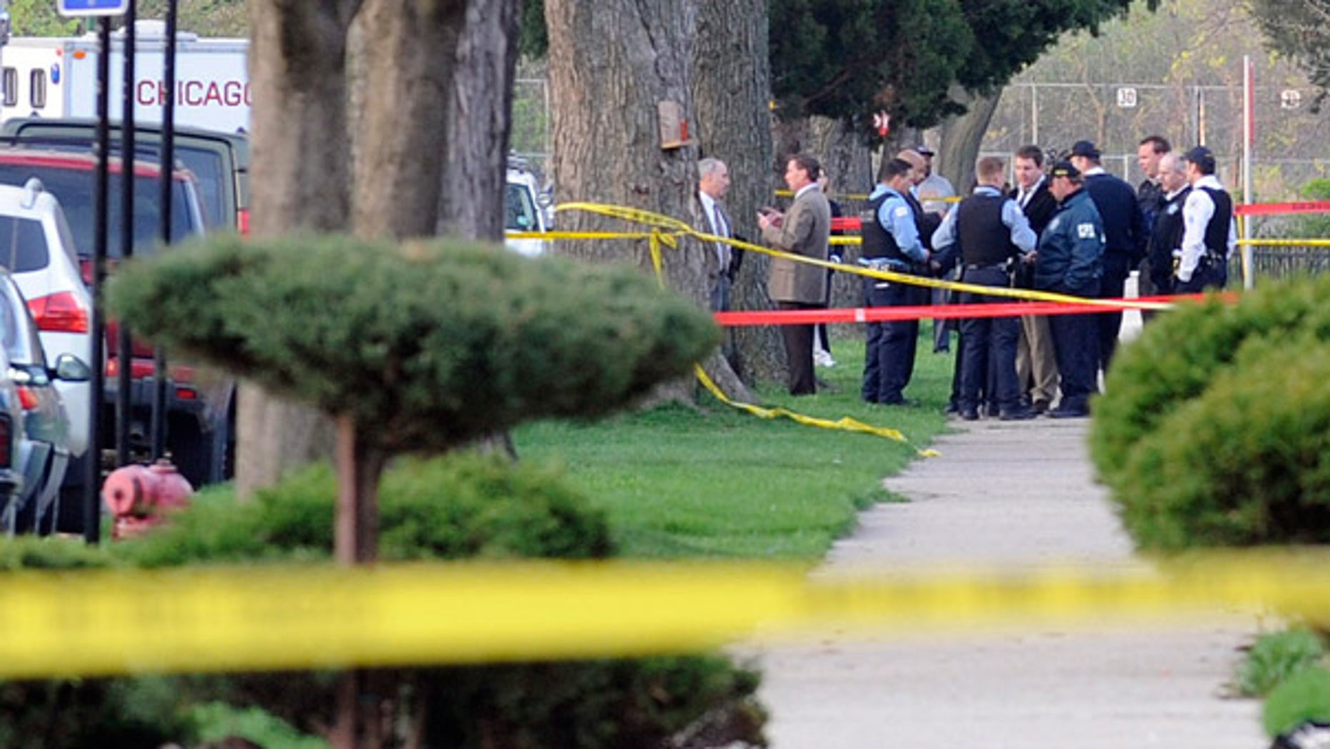 April 14: Chicago Police and investigators are seen following a shooting that left four people dead, including two children.