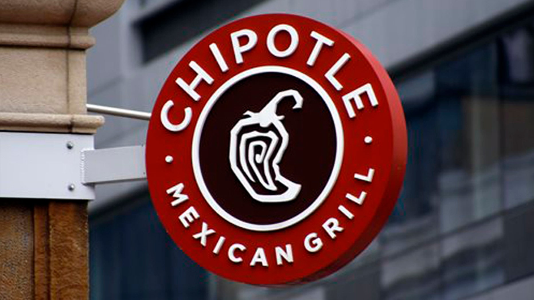 """This Monday, Feb. 8, 2016, photo shows a sign for the Chipotle restaurant in Pittsburgh's Market Square. Chipotle is introducing a temporary loyalty program intended to get customers back into its stores following a series of food scares. On Monday, June 27, Chipotle said its """"Chiptopia"""" loyalty program will reward people based on the number of times they visit each month, starting in July and running through September. The program has three reward levels, with more visits translating to more free entrees and other benefits. (AP Photo/Keith Srakocic)"""