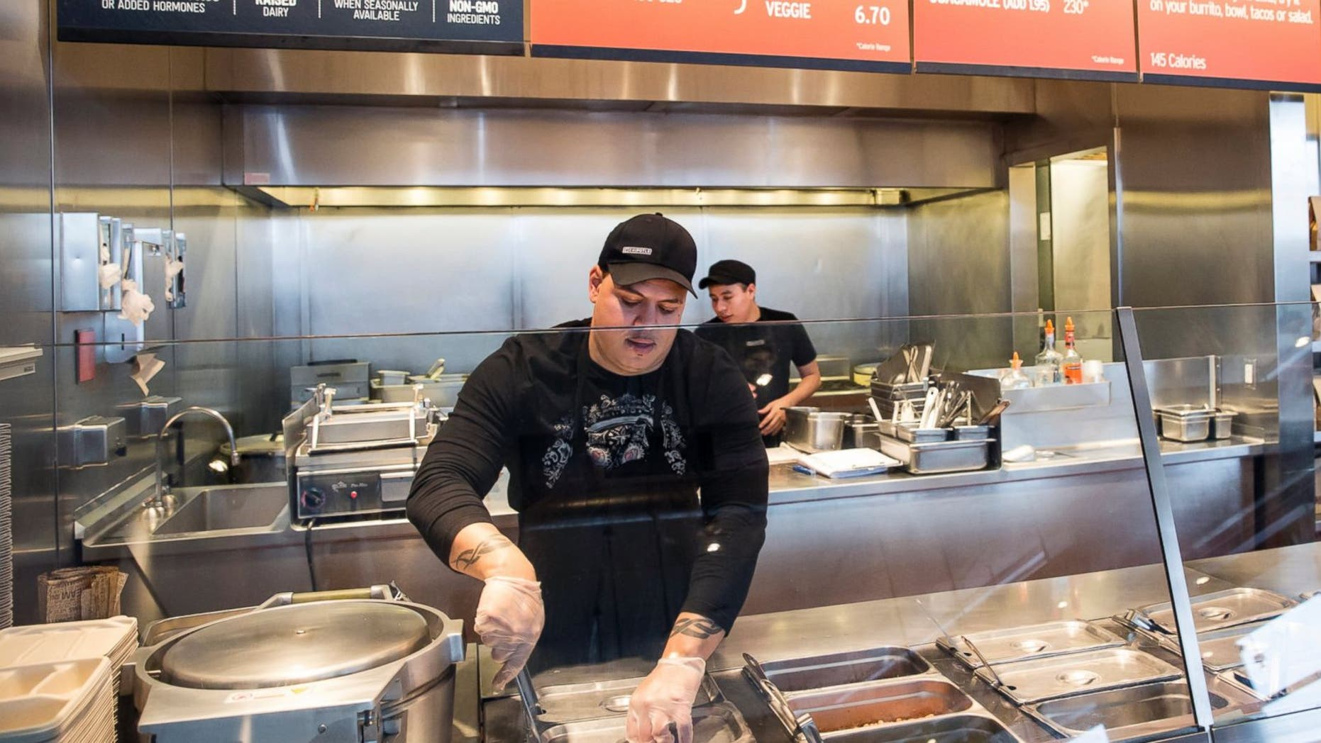 A Chipotle Mexican Grill employee prepares food in a Seattle location.