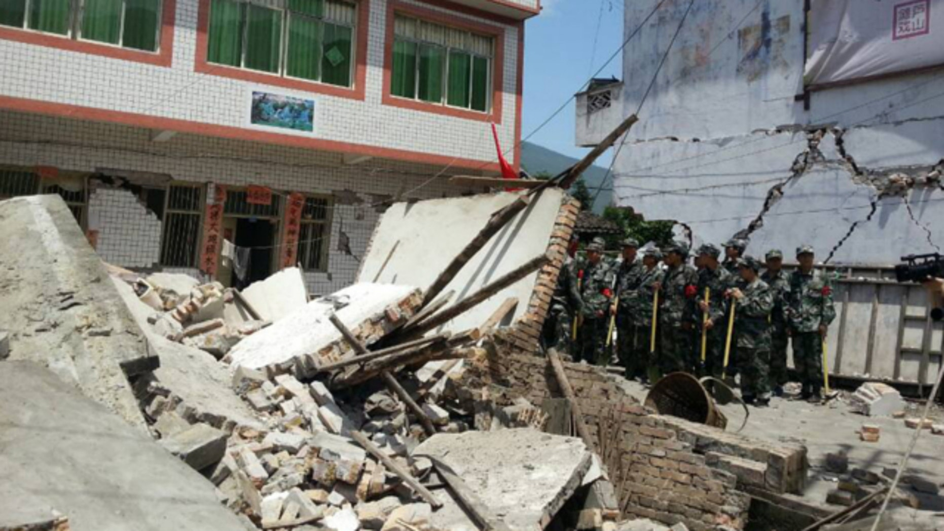 April 20, 2013: In this photo released by China's Xinhua news agency, buildings are destroyed by a powerful earthquake at Gucheng village of Longmen Township of Lushan County in Ya'an City, southwest China's Sichuan Province.