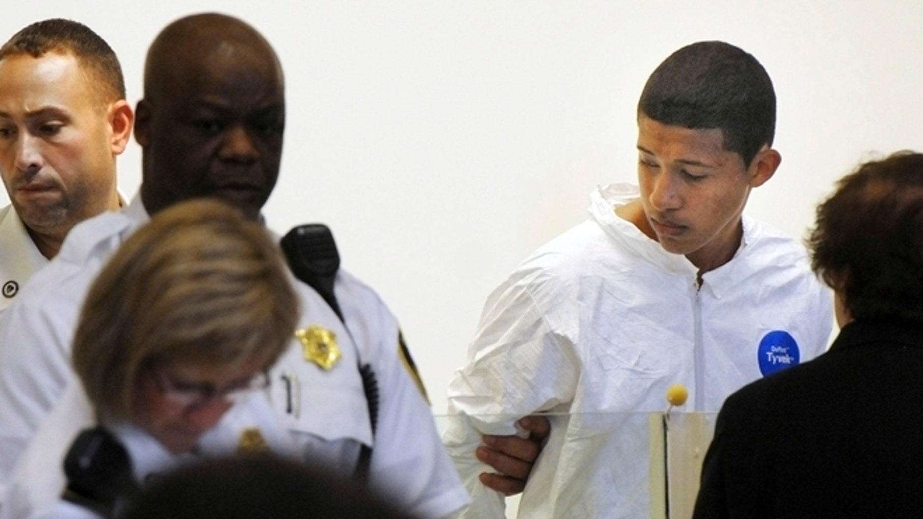 FILE 2013: Philip Chism, 14, stands during his arraignment for the death of Danvers High School teacher Colleen Ritzer in Salem District Court in Boston.