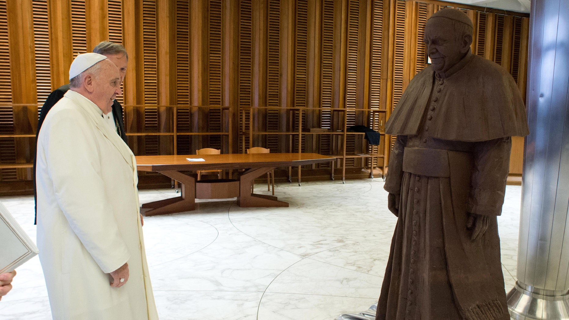 Feb. 6, 2014 - Pope Francis stands in front of a lifesize statue of chocolate of himself. The statue, made with 1.5 tons of cocoa, was presented to the Pope during the general audience of Feb. 5.