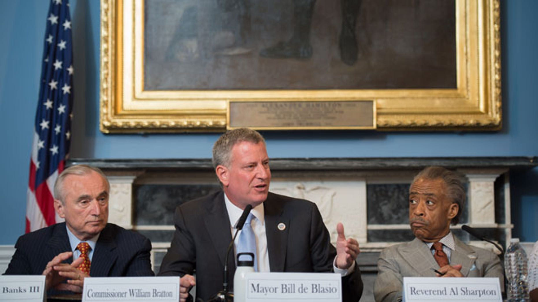 July 31, 2014: New York Mayor Bill de Blasio, center, is seated between New York City Police Commissioner William Bratton, left, and the Rev. Al Sharpton, during a roundtable discussion convened to ease tensions over the July 17 police-involved death of Eric Garner.