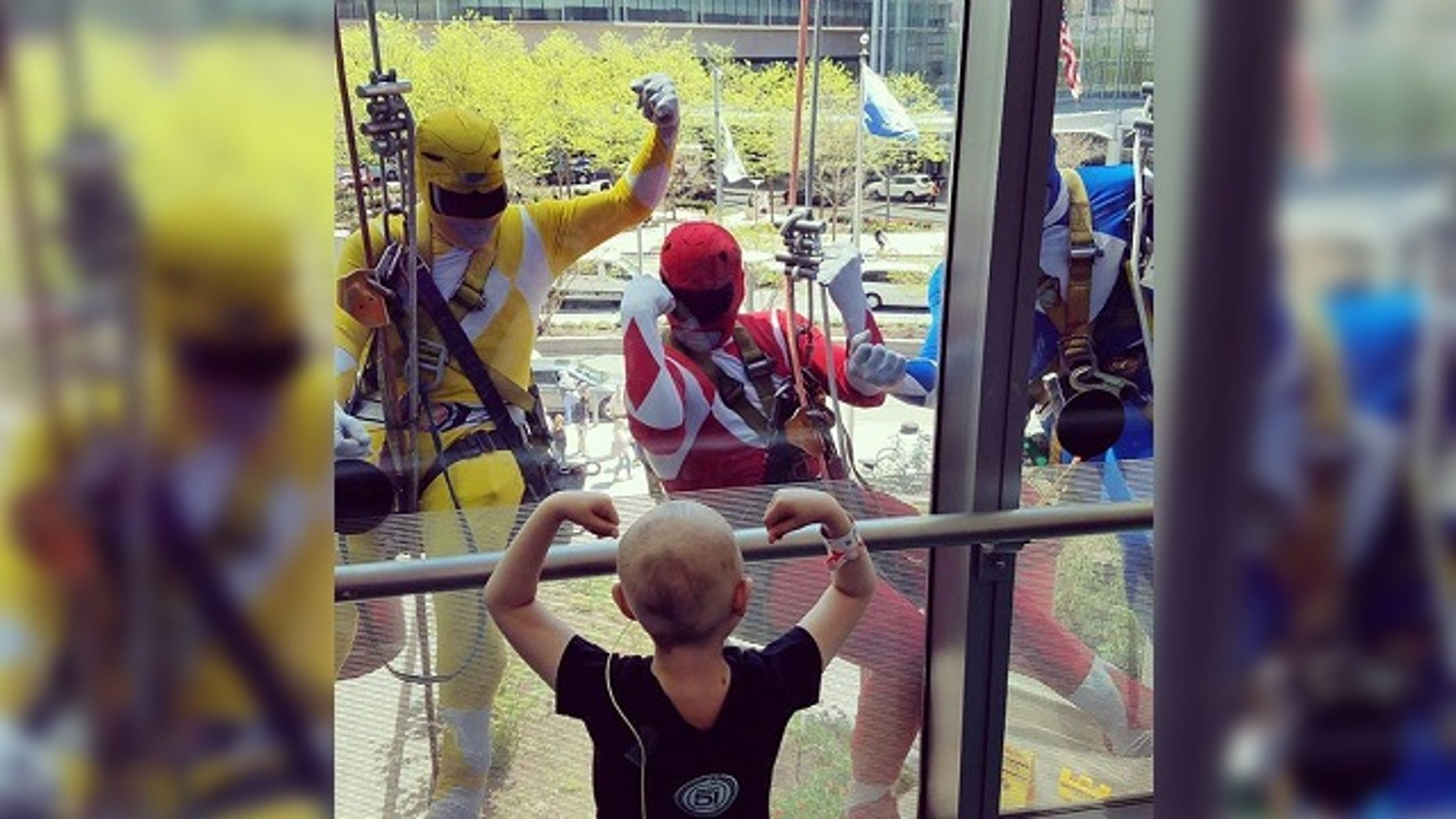 The hospital says the window washers are employees of Jenkintown Building Services, and that this isn't the first time they've dressed up for the children.