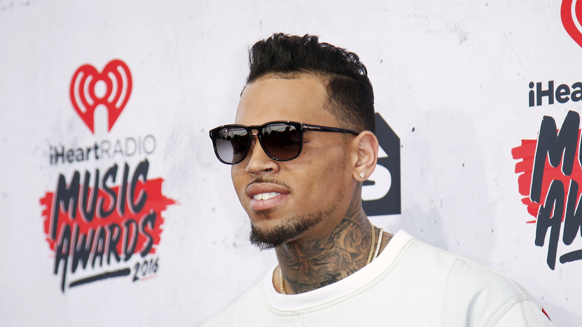 A lawyer for Chris Brown claims no drugs or guns were found at the singer's house.