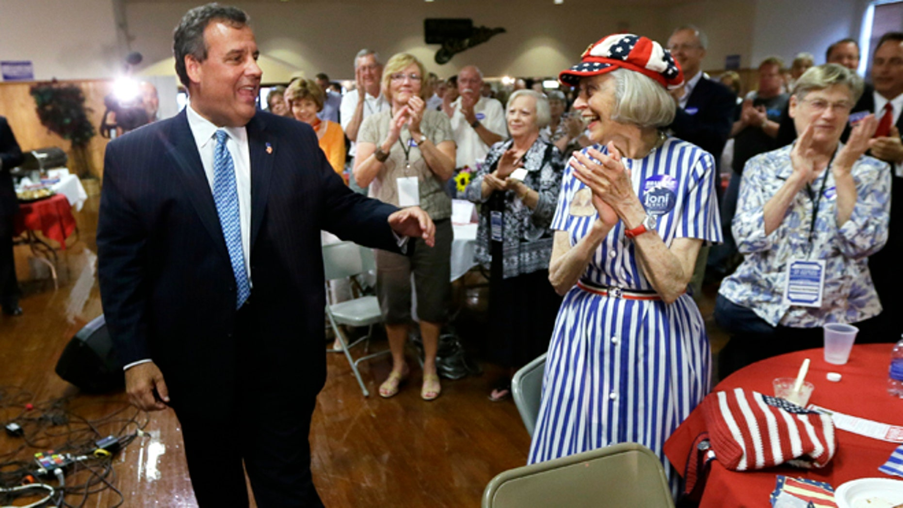 This July 17, 2014, file photo shows New Jersey Gov. Chris Christie greeting Iowans after speaking at a fundraiser for Iowa Gov. Terry Branstad in Davenport, Iowa.