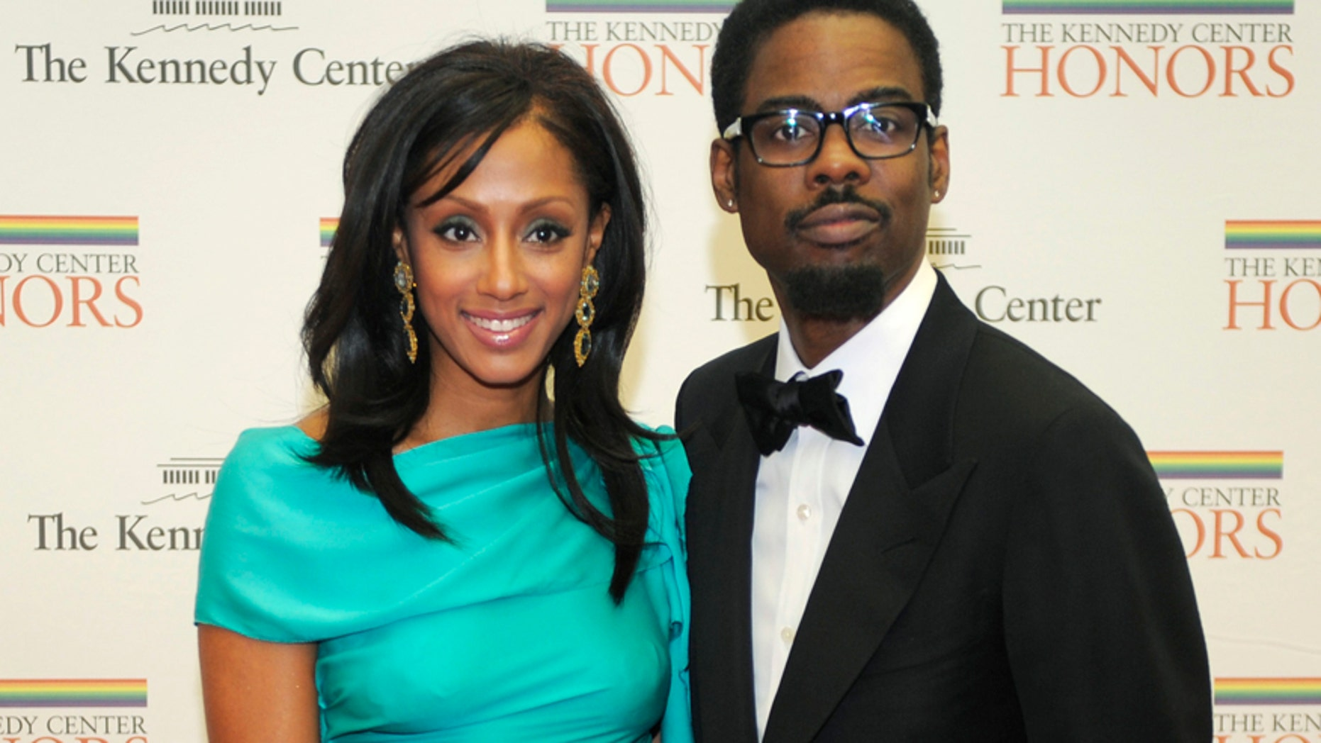 Comedian Chris Rock and his wife Malaak pose for photographers on the red carpet as they arrive at the State Department for a gala dinner for the 2010 Kennedy Center Honorees in Washington December 4, 2010.