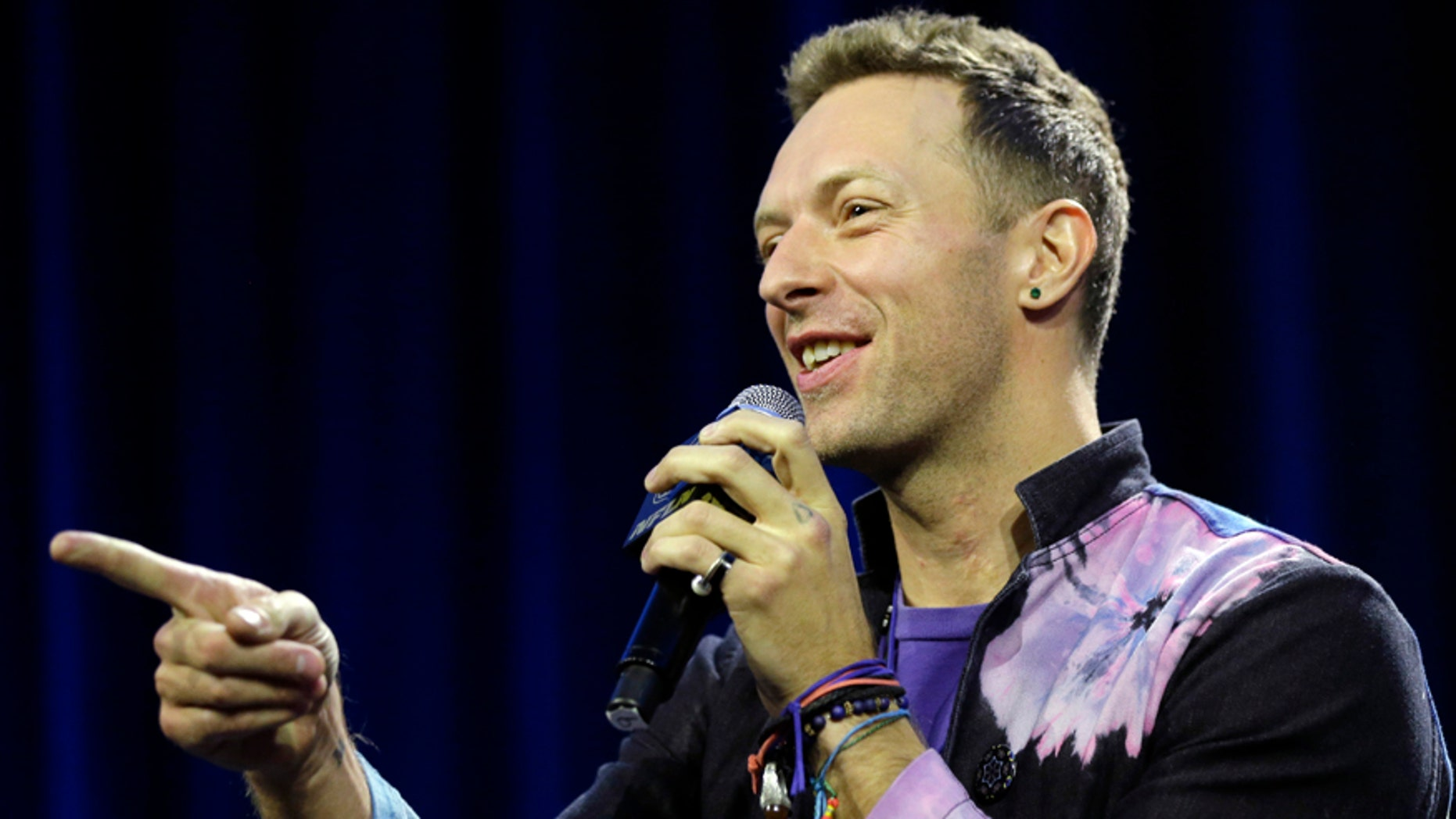 Chris Martin of Coldplay speaks during a halftime news conference for the upcoming NFL Super Bowl 50 football game Thursday, Feb. 4, 2016, in San Francisco. (AP Photo/David J. Phillip)
