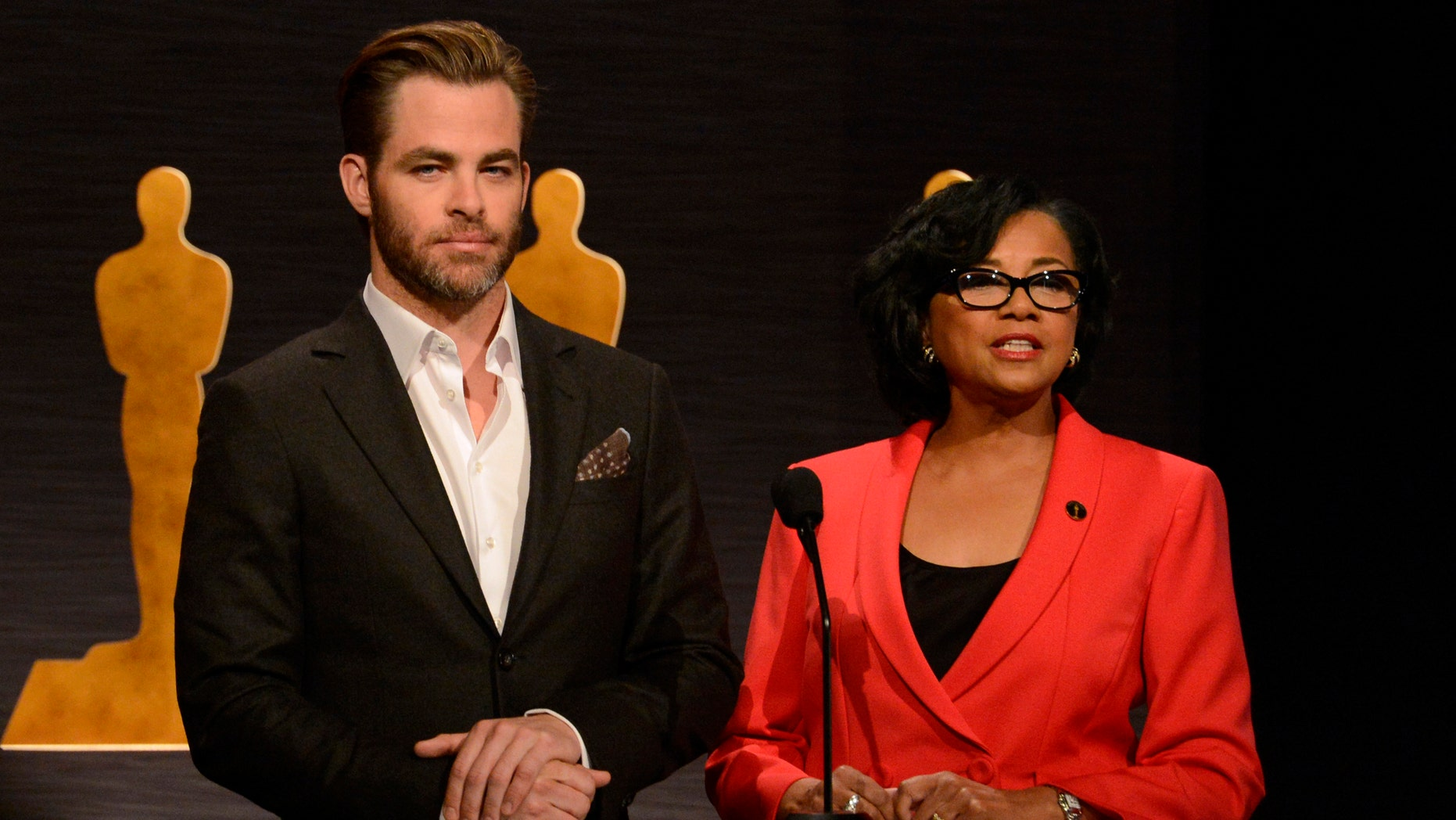 Actor Chris Pine (L) and Academy of Motion Picture Arts and Sciences President Cheryl Boone Isaacs (R) announce the nominees for Best Picture during the nominations announcement for the 87th Academy Awards in Beverly Hills, California January 15, 2015.  REUTERS/Phil McCarten  (UNITED STATES - Tags: ENTERTAINMENT) - RTR4LJLP