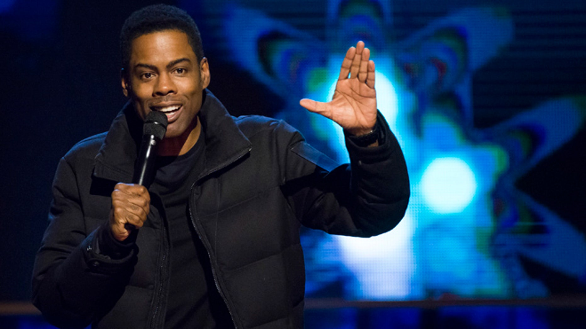 """Feb. 28, 2015. Chris Rock appears onstage at Comedy Central's """"Night of Too Many Stars: America Comes Together for Autism Programs"""" in New York."""