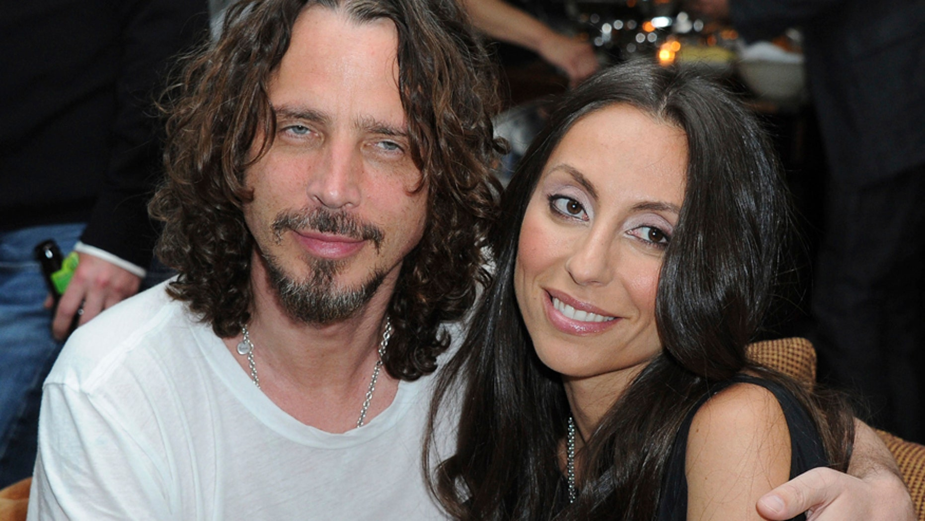 "In this April 27, 2012, file photo, Chris Cornell, at left, and his wife, Vicky Karayiannis attend the celebration of ""Commando: The Autobiography of Johnny Ramone,"" in Los Angeles."