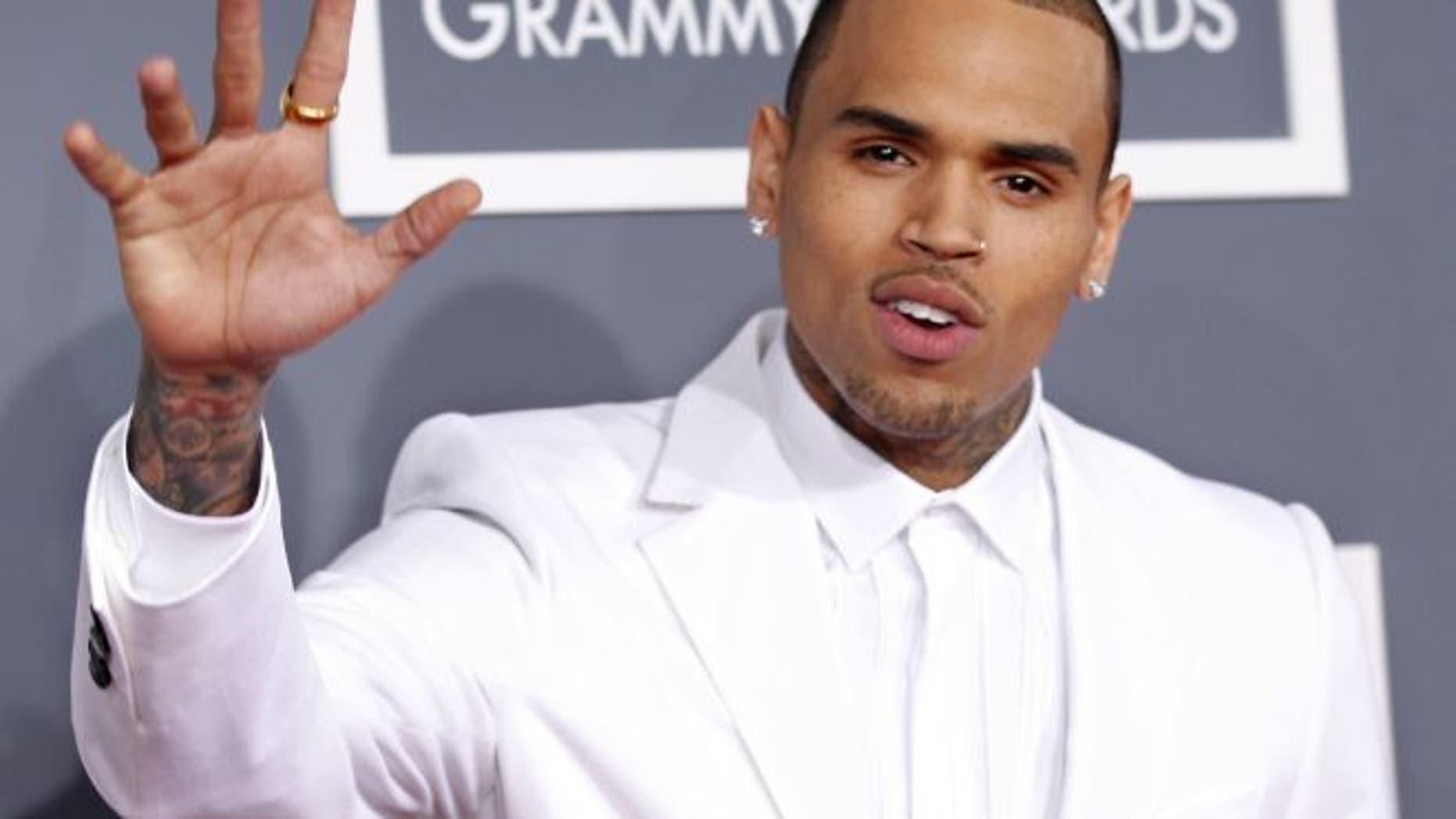 FILE: Feb. 10, 2013: Chris Brown arrives at the 55th annual Grammy Awards.