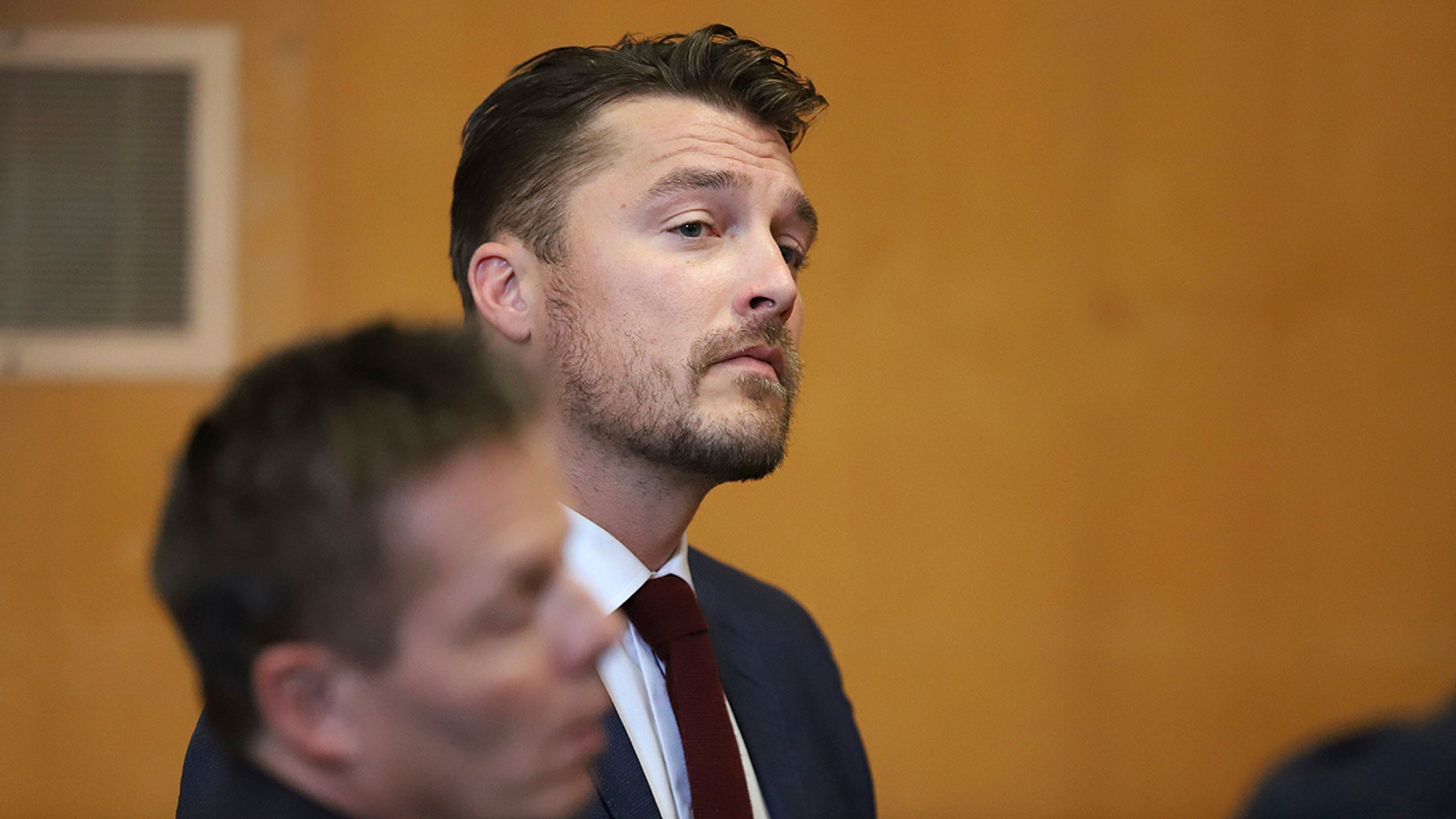 "Reality TV star Chris Soules, of ""The Bachelor,"" appears at a hearing in Buchanan County District Court with his lawyer Robert Montgomery, foreground, Thursday, Sept. 14, 2017, in Independence, Iowa. Soules is charged with leaving the scene of an April 24 crash in which he rear-ended a tractor, killing 66-year-old Kenneth Mosher. (Matthew Putney/The Courier via AP, Pool)"
