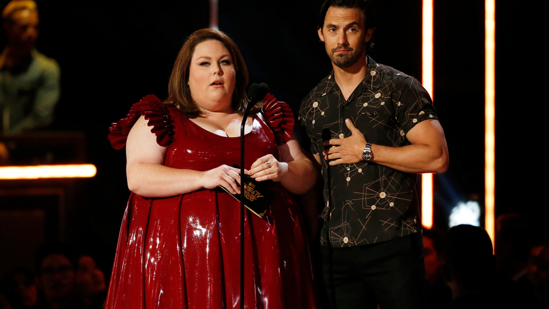 Chrissy Metz and Milo Ventimiglia present an award at the 2017 MTV Movie and TV Awards.