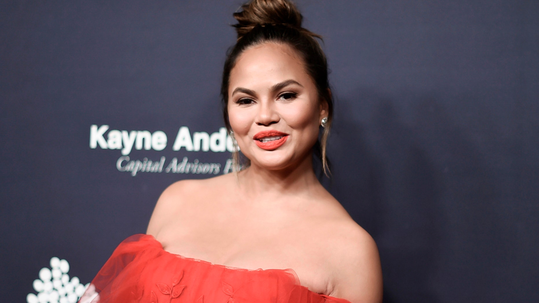 "FILE - In this Nov. 11, 2017 file photo, Chrissy Teigen attends the 6th Annual Baby2Baby Gala honoring Gwyneth Paltrow in Culver City, Calif.  Teigen, famous for her unfiltered comments on social media, spoke to the Associated Press, Friday, March 30, 2018, to promote her creative consultant role with Pampers, and her singer husband John Legend's upcoming live performance in ""Jesus Christ Superstar Live"" on NBC. (Photo by Richard Shotwell/Invision/AP, File)"