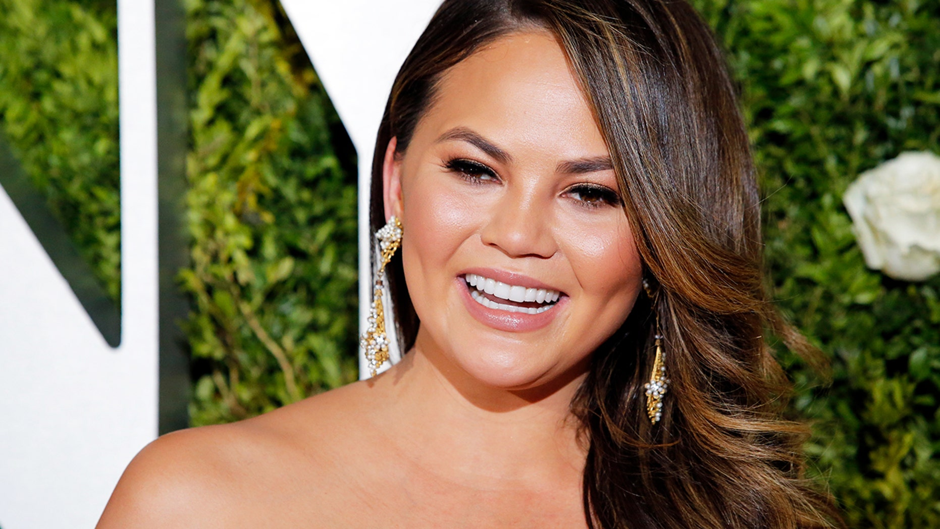 "Model Chrissy Teigen posted an honest video about her ""period skin"""