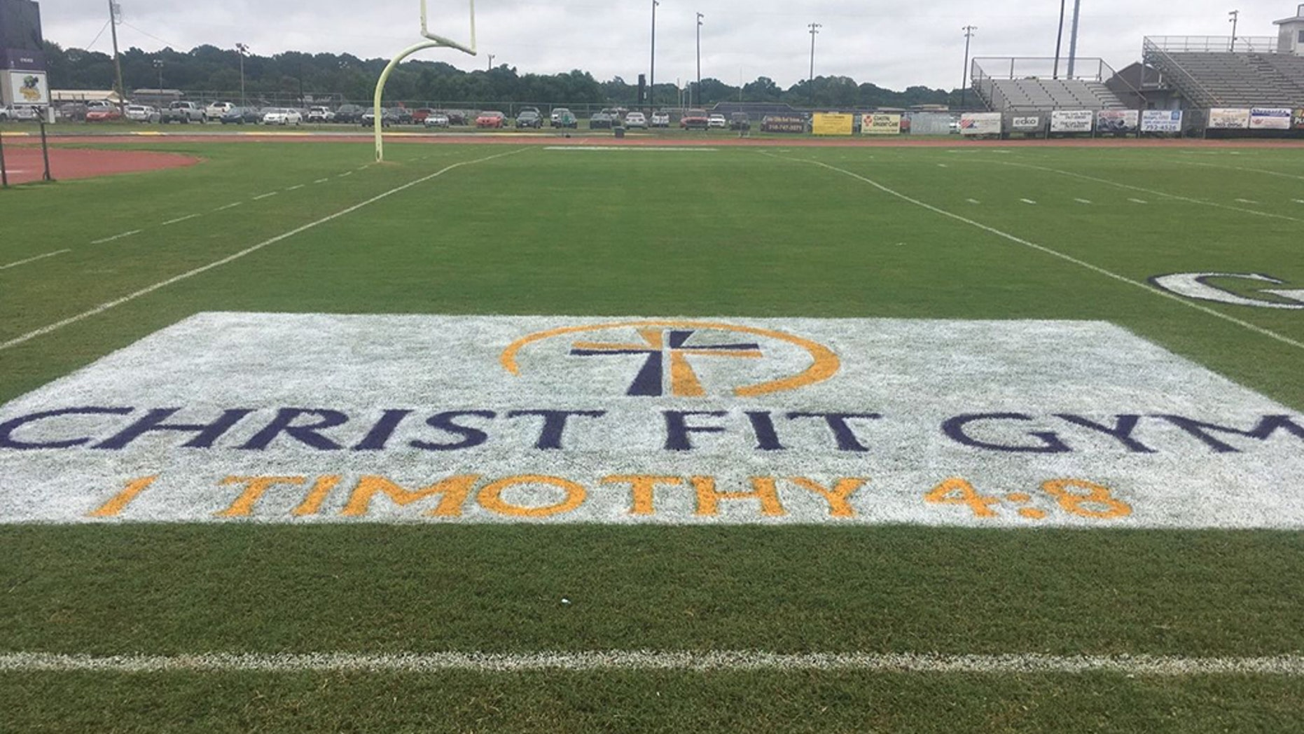 "Two Benton High School students were ordered to remove a logo from the football field end zones because it included Christian references. The logo belonged to Christ Fit Gym, a faith-based gymnasium in nearby Bossier City, Louisiana. It included the words ""Christ Fit Gym,"" a cross and a Bible verse reference, 1 Timothy 4:8."