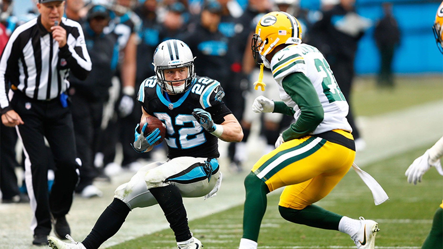 Carolina Panthers running back Christian McCaffrey (No. 22) is being hailed a hero by a Colorado family for his actions that saved a grandfather's life..