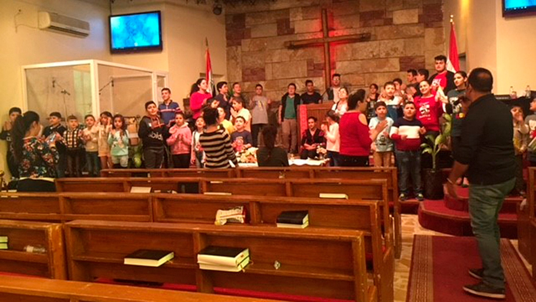 """Children sing """"Jingle Bells"""" and rehearse a Nativity play at the Alliance Evangelical Church in Baghdad."""