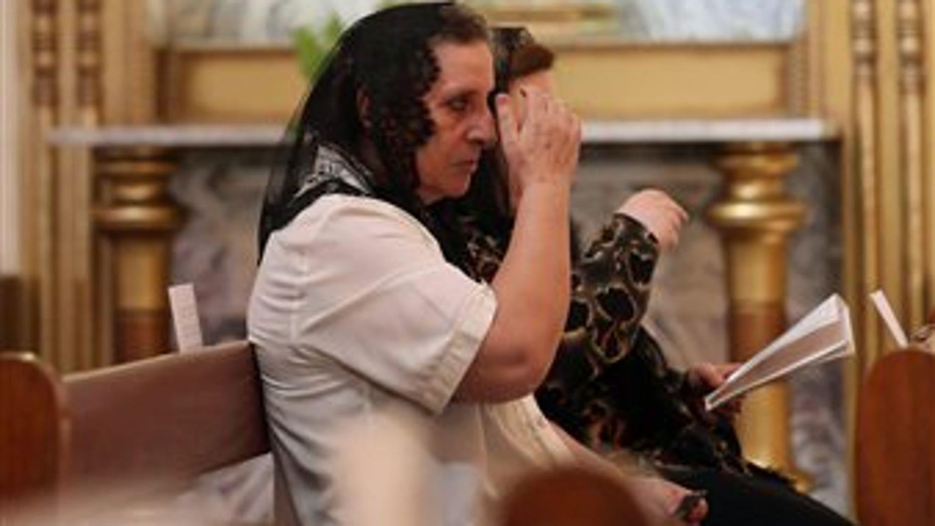 Iraqi Christians pray during Sunday Mass at the Church of Virgin Mary in Baghdad, Sunday, July 27, 2014. (AP Photo/Hadi Mizban)