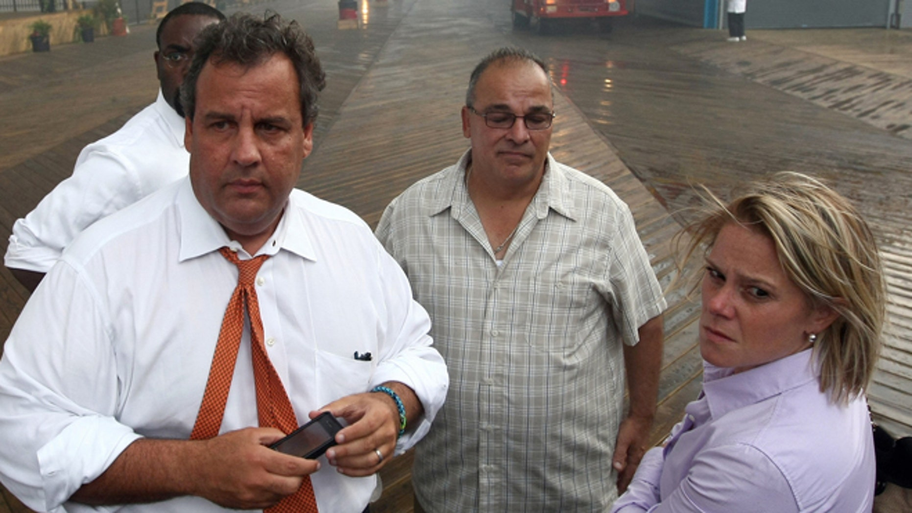 Sept. 12, 2013: Deputy Chief of Staff Bridget Anne Kelly, right, stands with Gov. Chris Christie, left, during a tour of the Seaside Heights, N.J. boardwalk after it was hit by a massive fire.