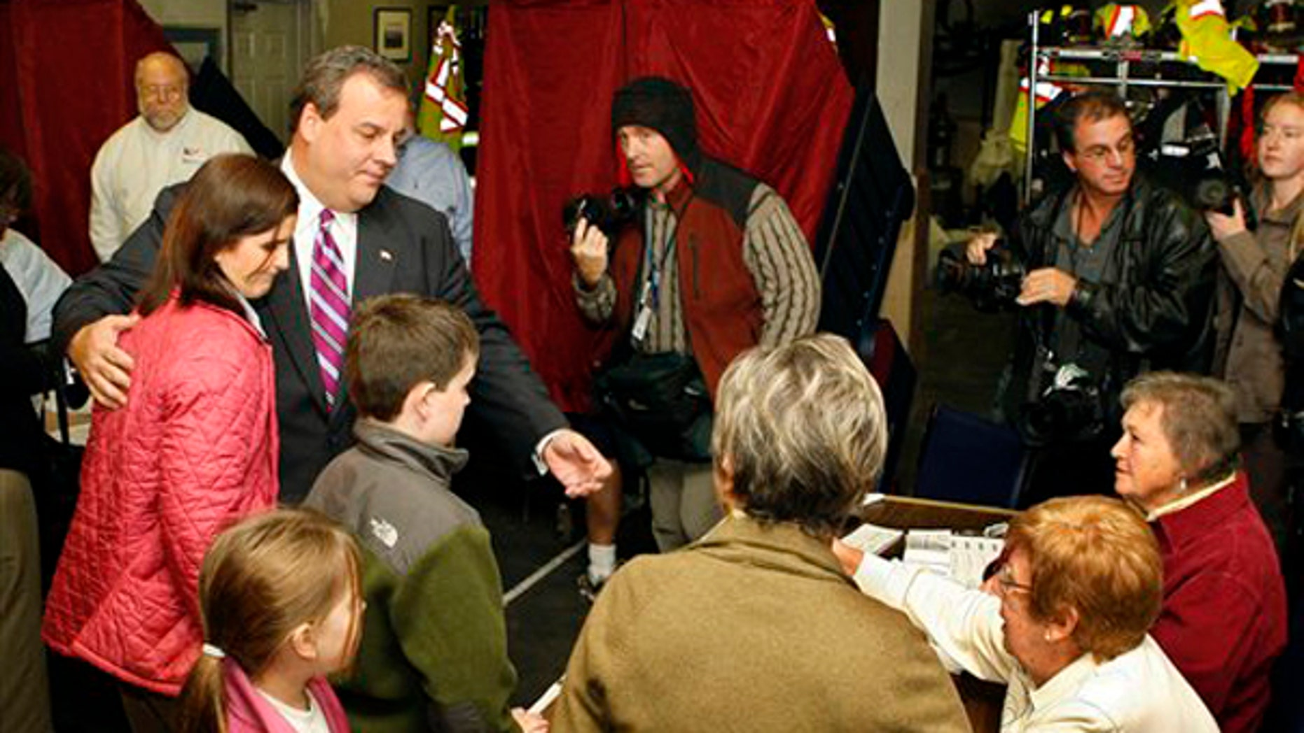 Tuesday: Chris Christie stands with wife Mary Pat Christie and children Bridgett and Patrick ahead of their voting in Mendham, N.J. (AP Photo)