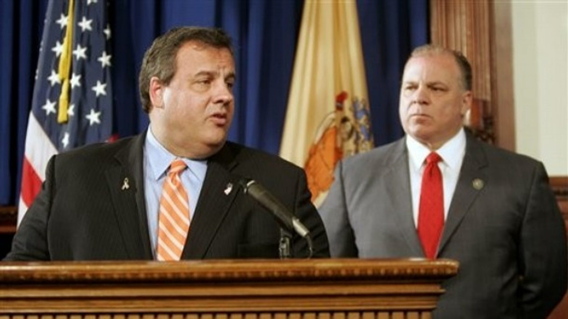 FILE: In this May, 2, 2011, photo, New Jersey Gov. Chris Christie and Senate President Stephen M. Sweeney discuss Supreme Court vacancies. They are now working together on health benefits contributions from state workers.