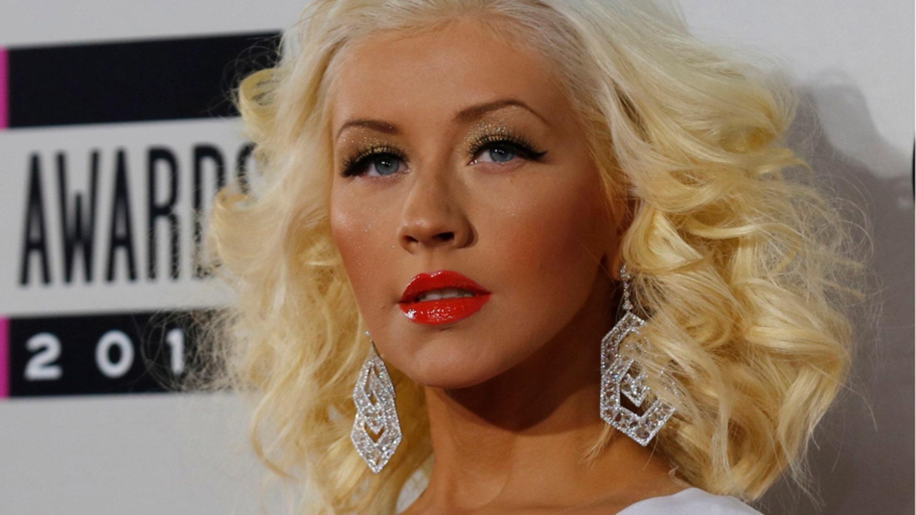 Musician Christina Aguilera arrives at the 41st American Music Awards in Los Angeles, California November 24, 2013.