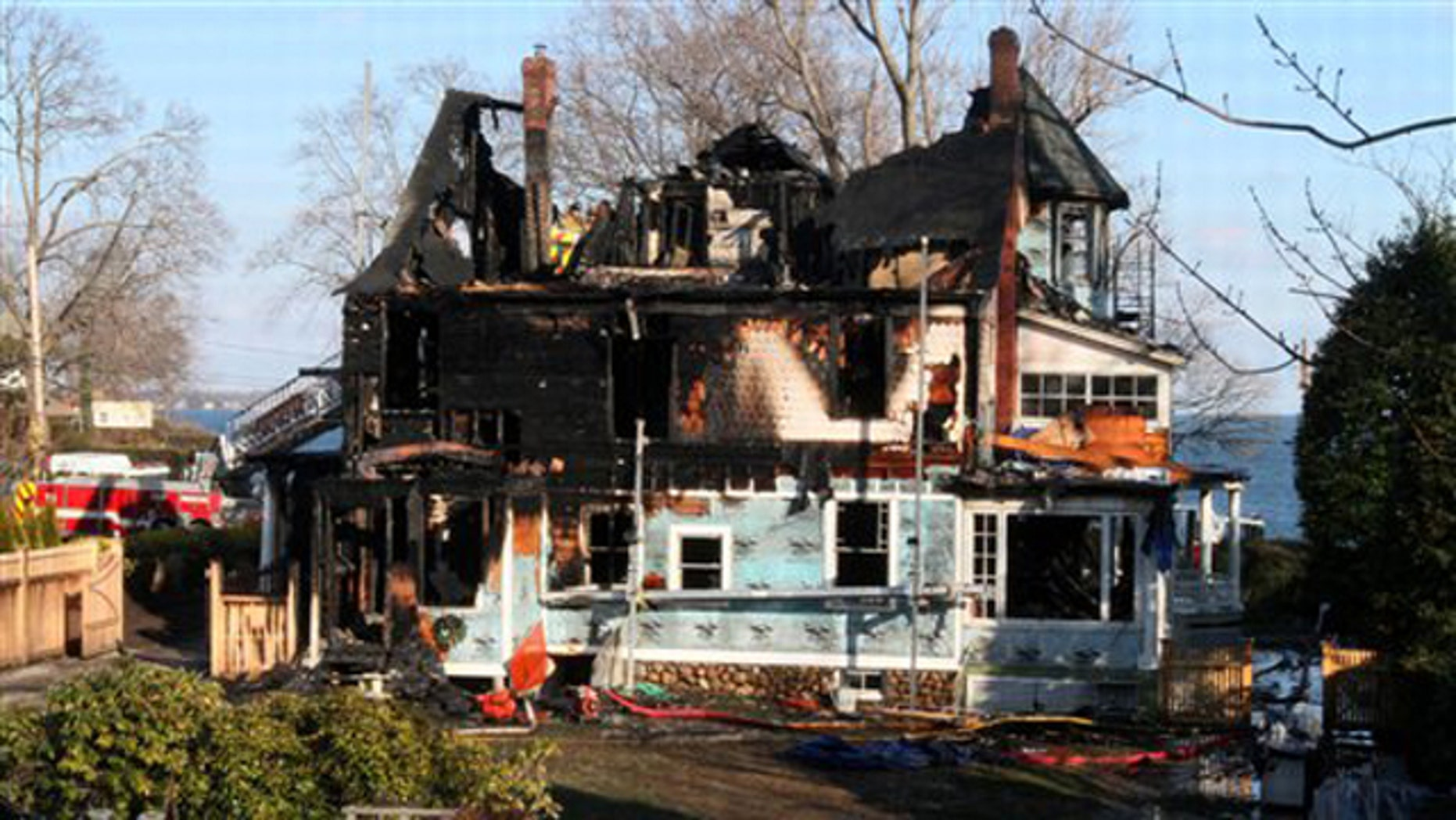 Dec. 25, 2011: In this file photo, firefighters investigate a house where an early morning fire left five people dead, in Stamford, Conn.